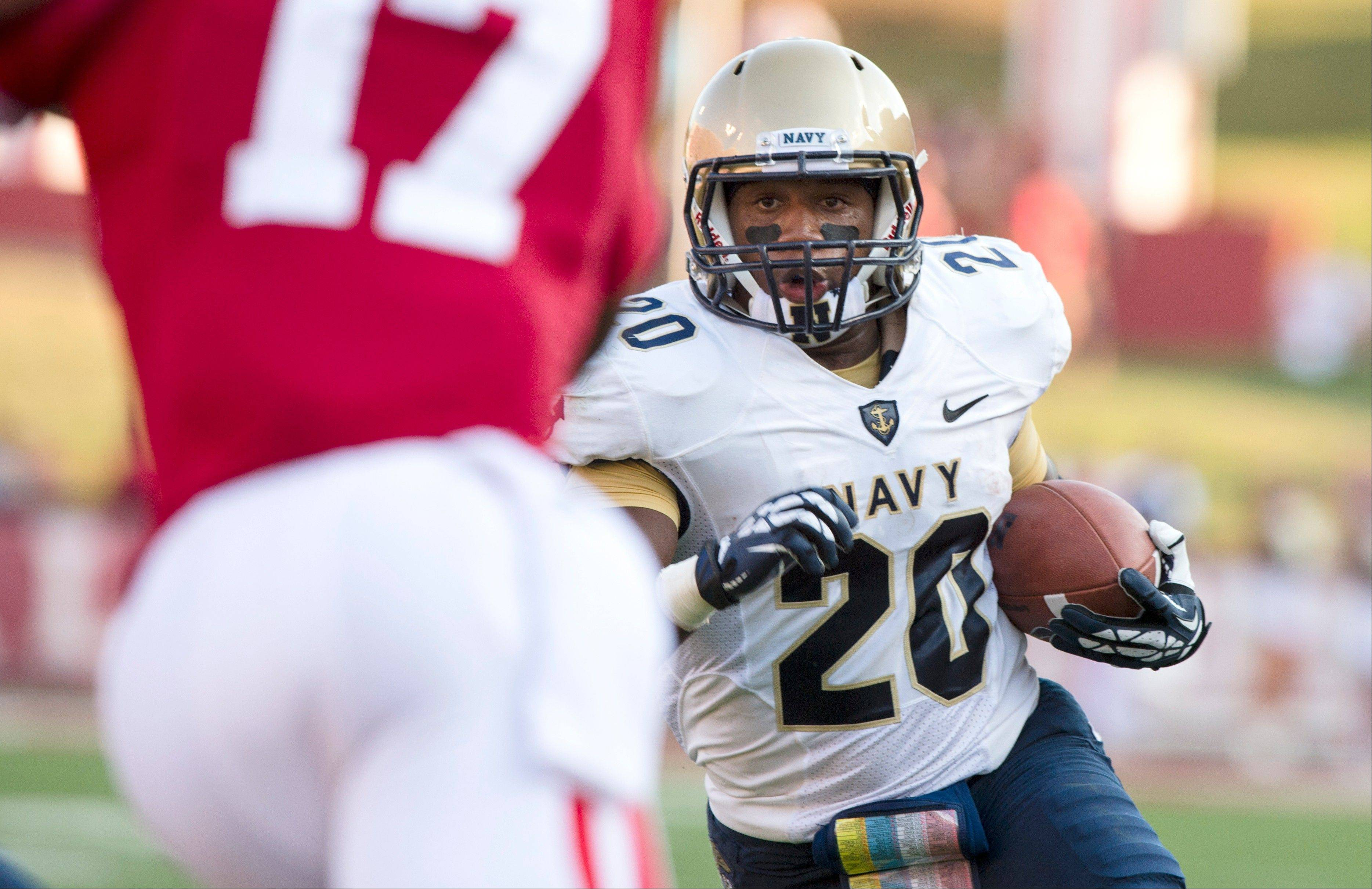 Navy�s Darius Staten runs into the Indiana secondary during the first half Saturday in Bloomington, Ind.