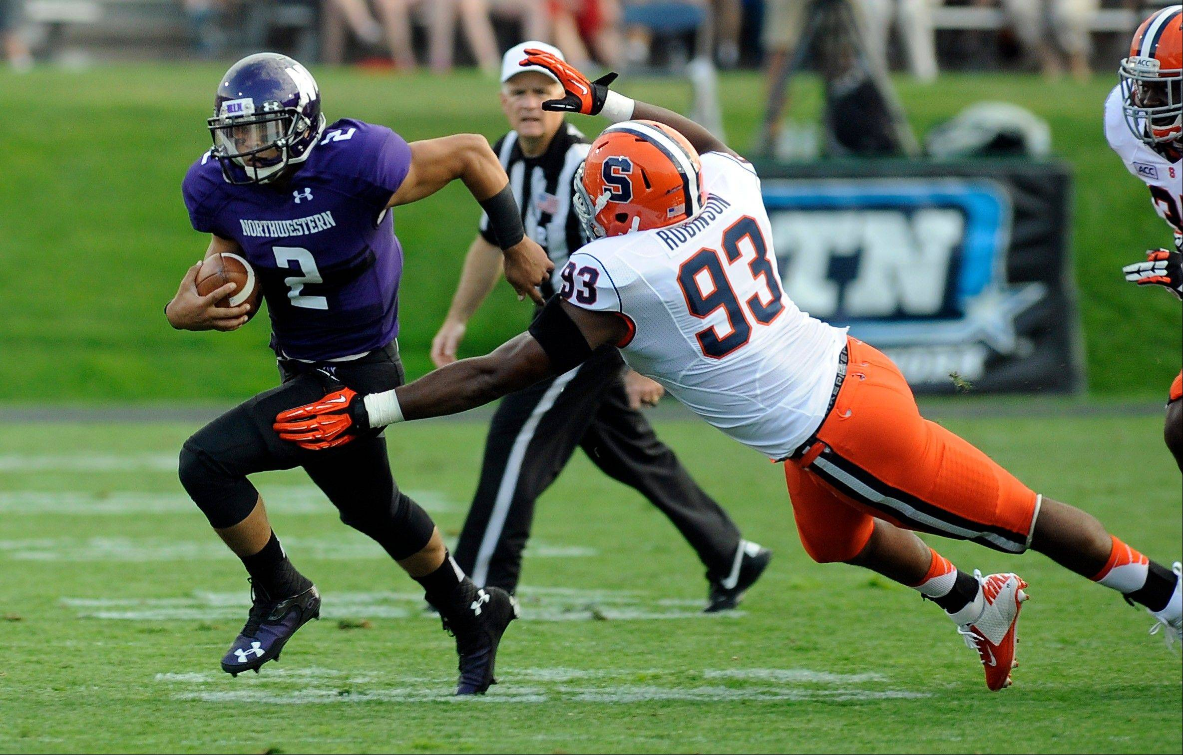 Syracuse's Micah Robinson chases Northwestern University's Kain Colter during the first half of Saturday's game in Evanston.