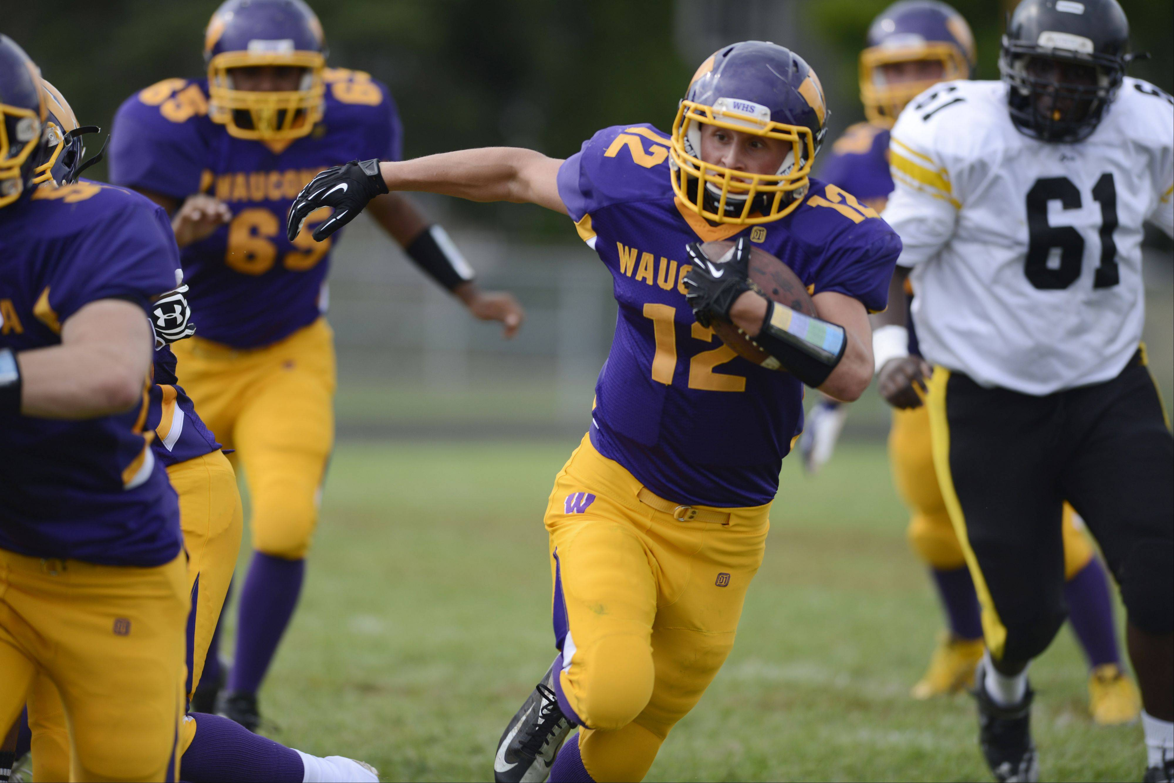 Wauconda�s Alex Payne carries the ball during Saturday�s game against Orr.