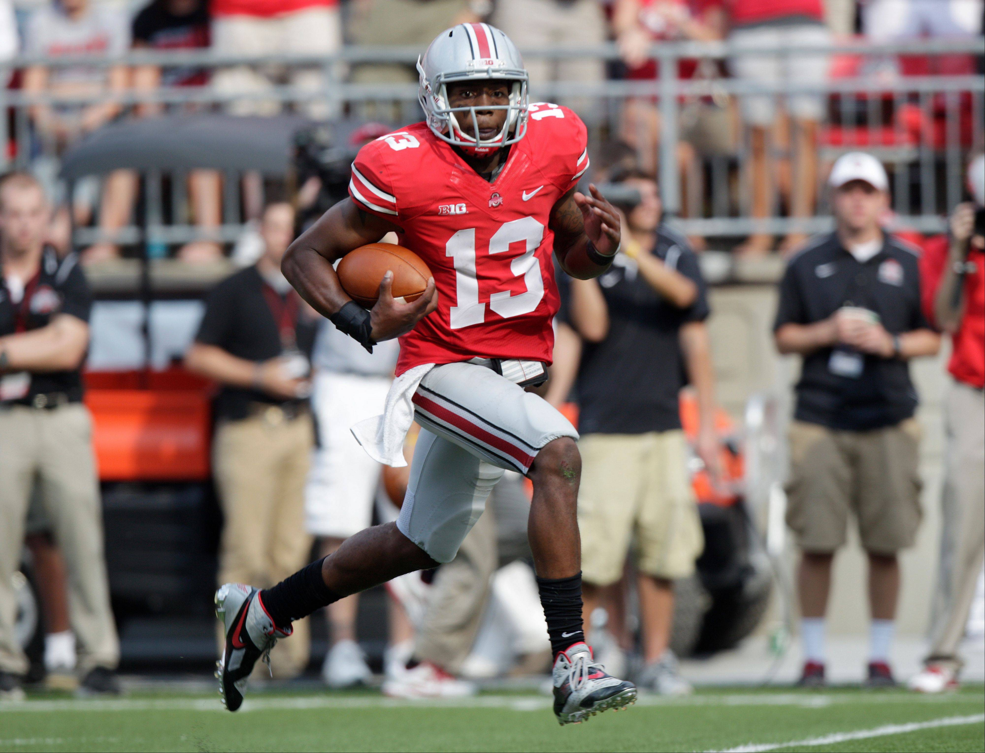 Ohio State backup quarterback Kenny Guiton breaks away for a touchdown run against San Diego State during the second quarter Saturday in Columbus, Ohio.