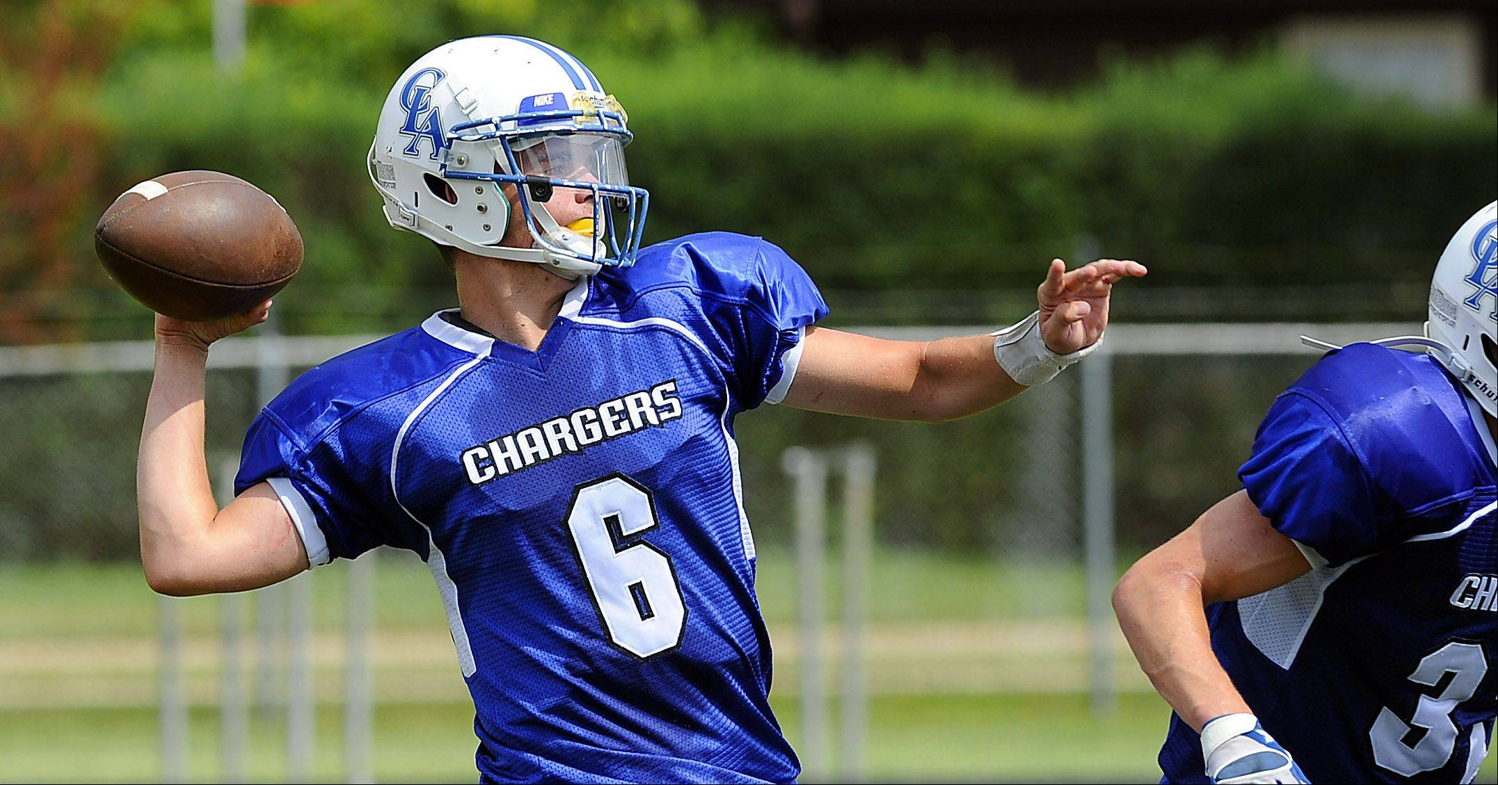 Christian Liberty quarterback Gabe Grob fires downfield against Marquette Academy on Saturday in Arlington Heights.