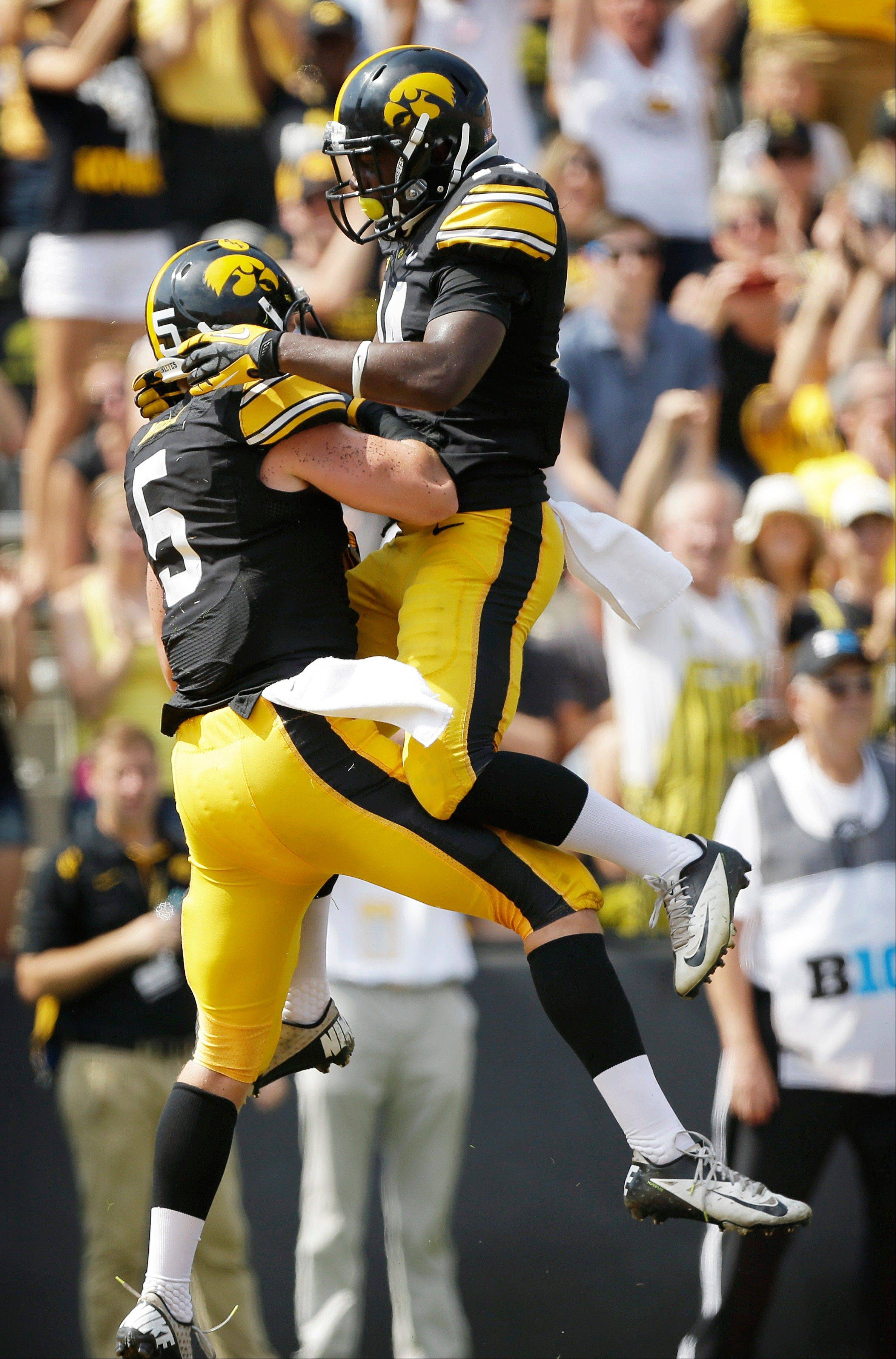 Iowa defensive back Tanner Miller, left, celebrates with teammate Desmond King after intercepting a pass in the end zone during the second half of Saturday�s game against Missouri State in Iowa City, Iowa.