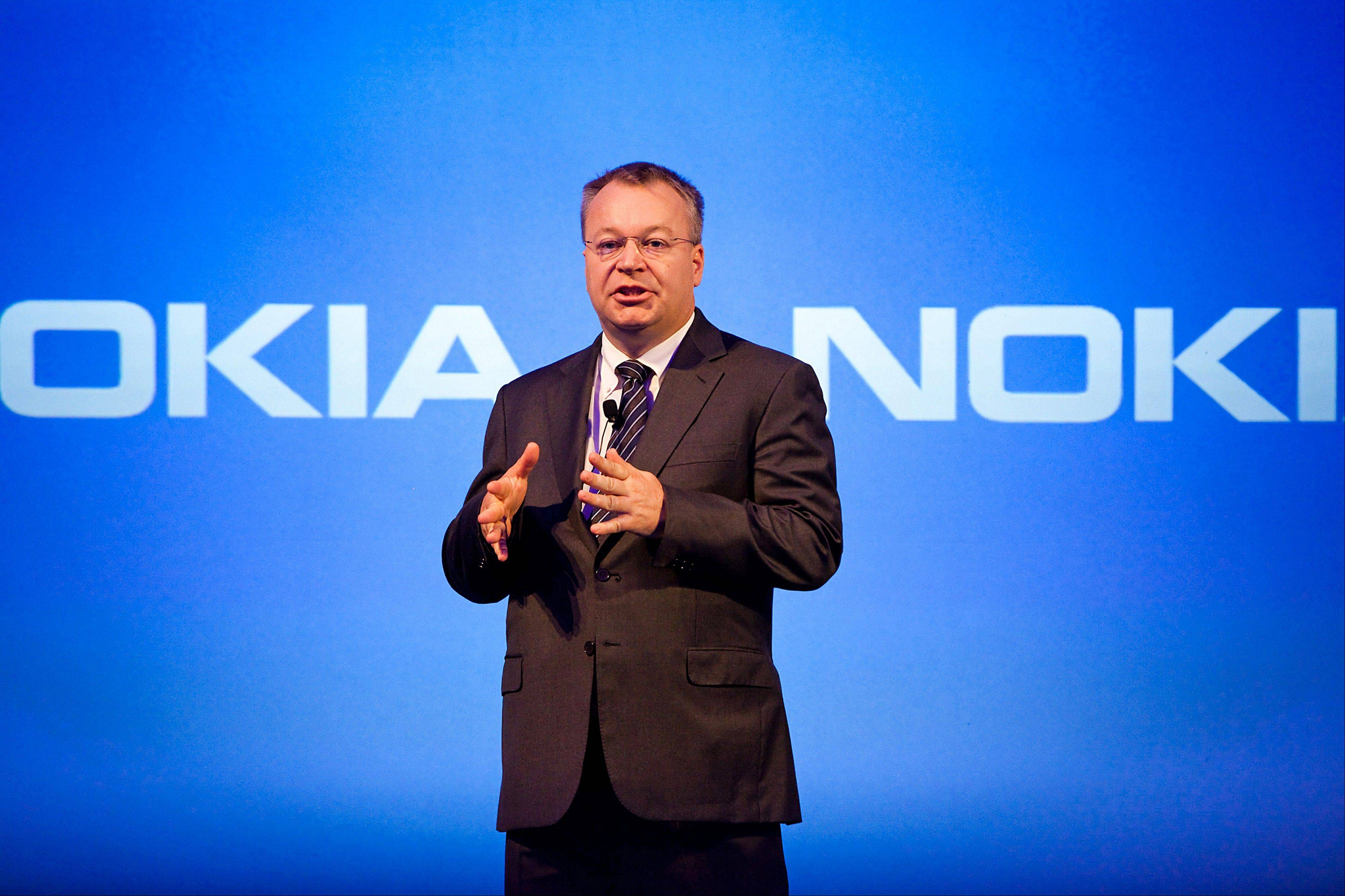 Stephen Elop, outgoing chief executive officer of Nokia Oyj, speaks Tuesday during a news conference at the Dipoli conference center in Espoo, Finland. Microsoft Corp. agreed to buy Nokia Oyj's handset business and license its patents for$7.2 billion, casting together the lot of two companies trying to stay relevant against fleet-footed technology rivals.