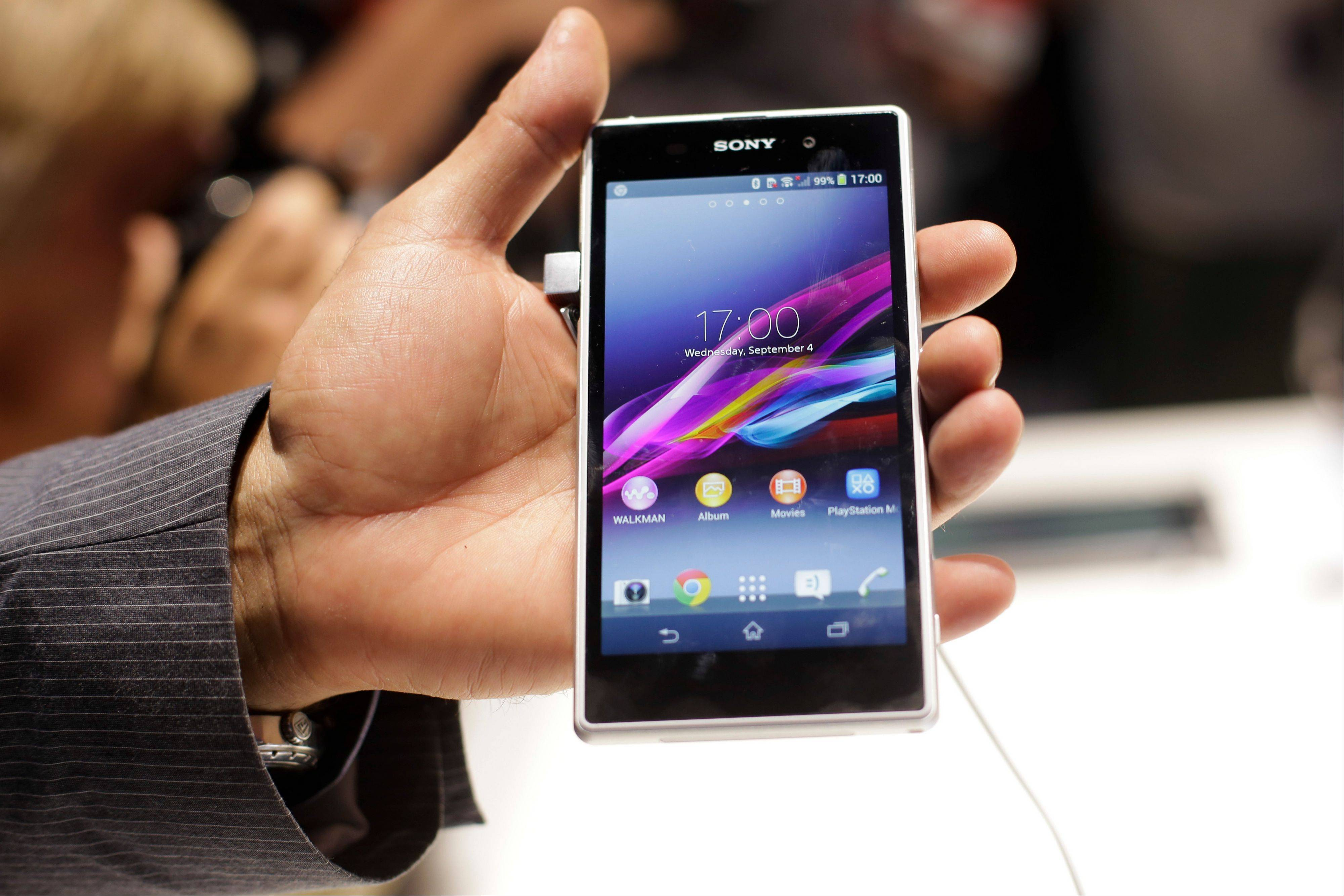 A man shows the new Sony Xperia Z1 smartphone at a Sony event ahead of the IFA, one of the world's largest trade fairs for consumer electronics and electrical home appliances, in Berlin.