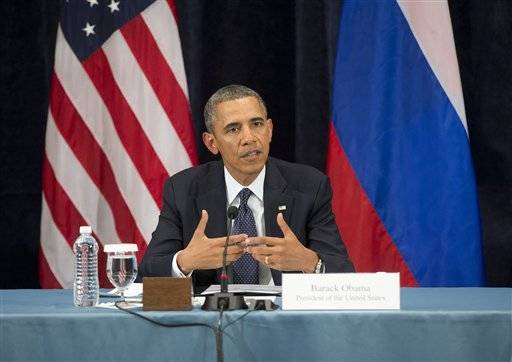 "President Barack Obama gestures while speaking during a ""Civil Society Roundtable"" with gay, lesbian, bisexual and transgender activists, Friday, Sept. 6, 2013, in St. Petersburg, Russia."