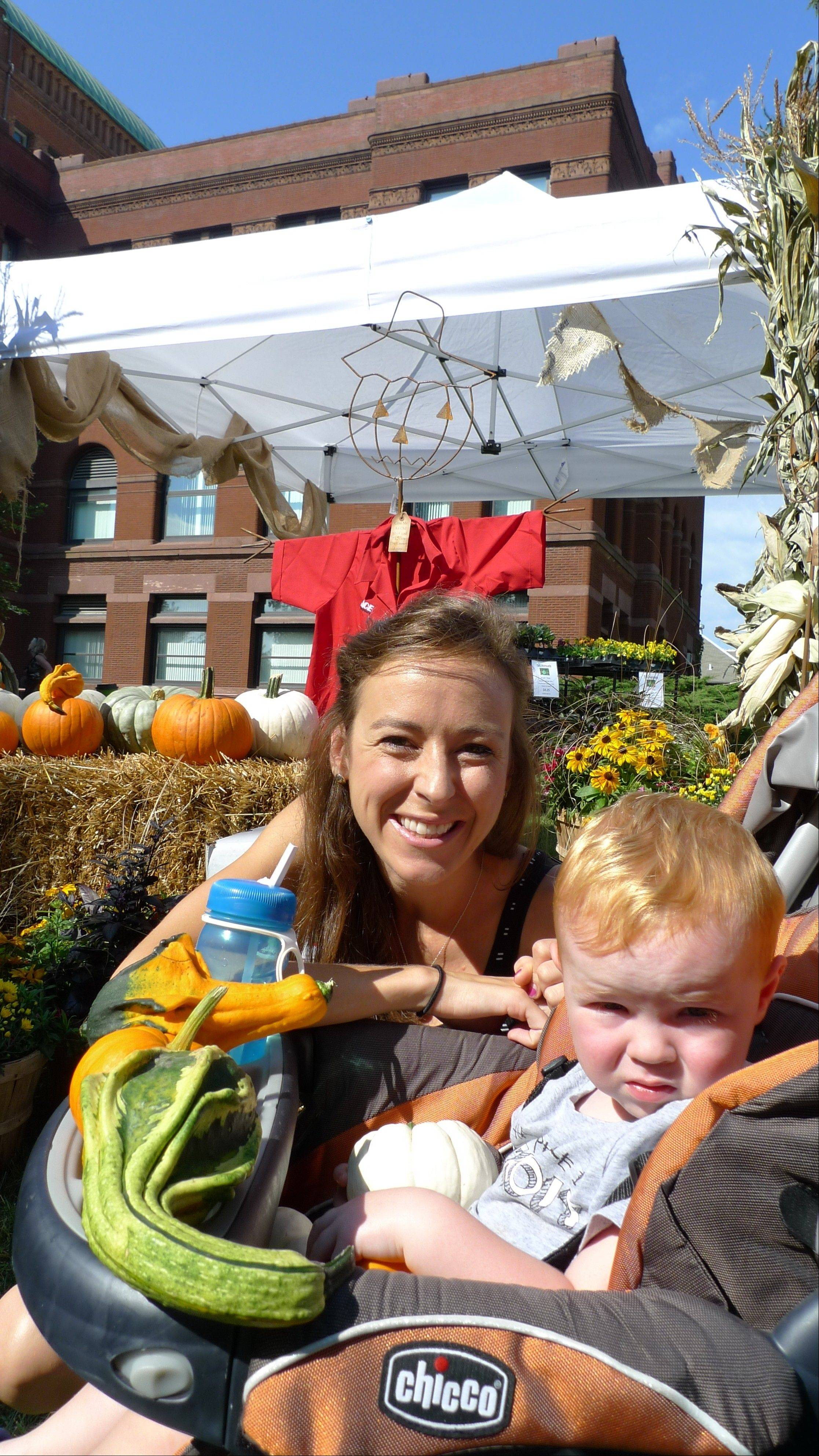 Julie O'Malley of St. Charles shops for gourds with son Rowin at Geneva's Festival of the Vine on Saturday.