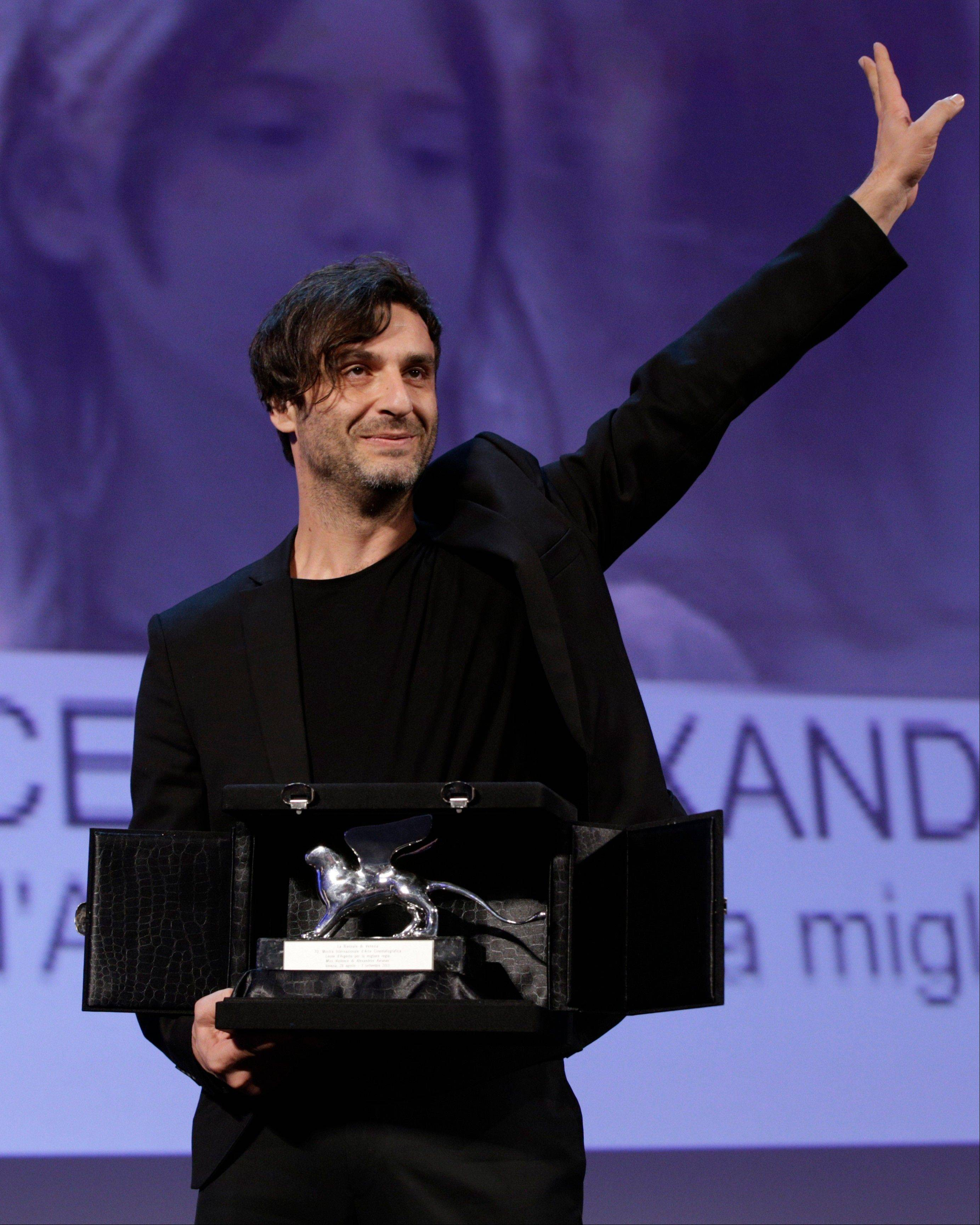 Director Alexandros Avranas holds the Silver Lion for Best Director for the film Miss Violence, during the awards ceremony of the 70th edition of the Venice Film Festival in Venice, Italy, Saturday.