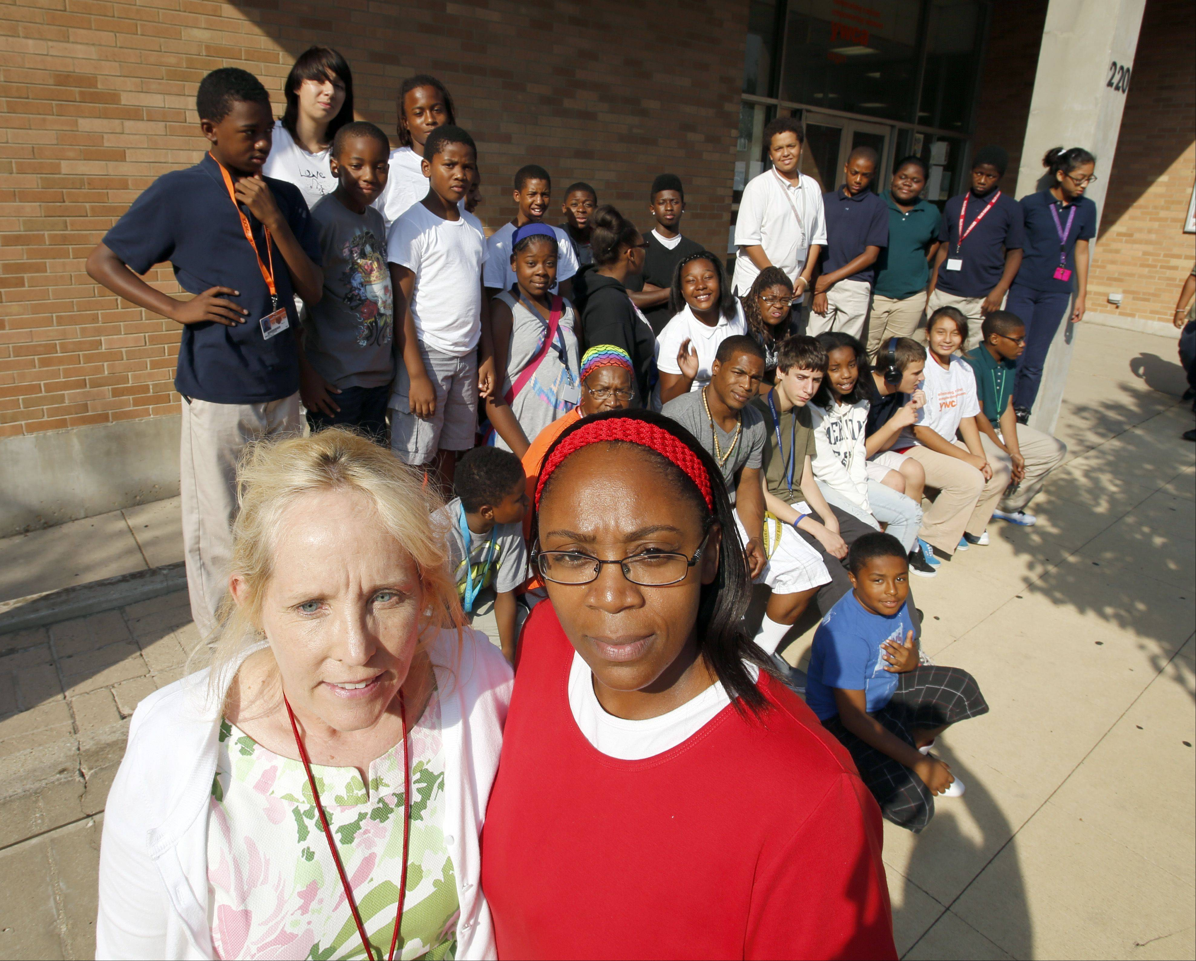 Julia McLendon, chief executive officer of the YWCA in Elgin and India Smith, its youth services director, say that about 30 black kids from their Teen Reach program were racially profiled during a field trip to the Dolphin Cove Family Aquatic Center in Carpentersville. Many of the teens pictured were a part of the outing. A Dundee Township Park District official, however, says the kids weren't following aquatic center rules.