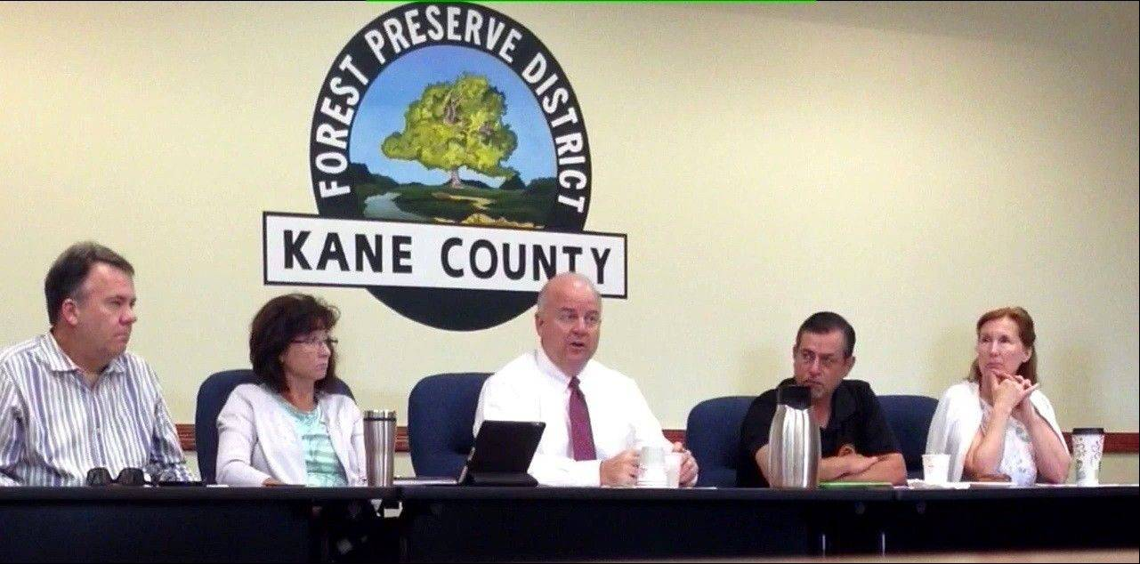 Kane County Forest Preserve District President John Hoscheit, center, sold a panel of commissioners Friday on the idea of a $150,000 property tax increase. Every commissioner on the panel voted in favor of the increase except Theresa Barreiro, pictured to the right of Hoscheit.