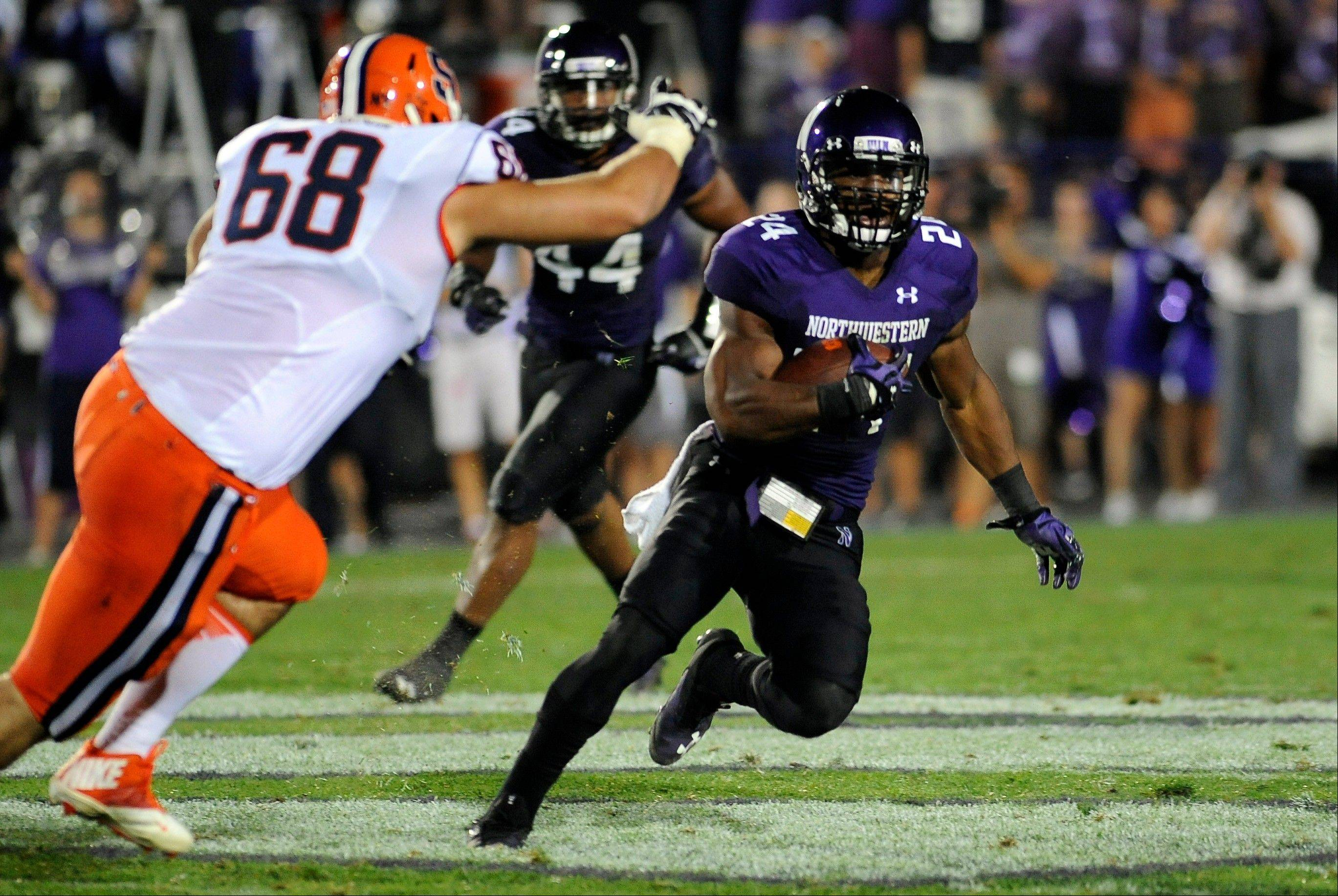 Northwestern's Ibraheim Campbell runs with an interception in the second half of an NCAA college football game against Syracuse in Evanston, Ill., Saturday, Sept. 7, 2013.