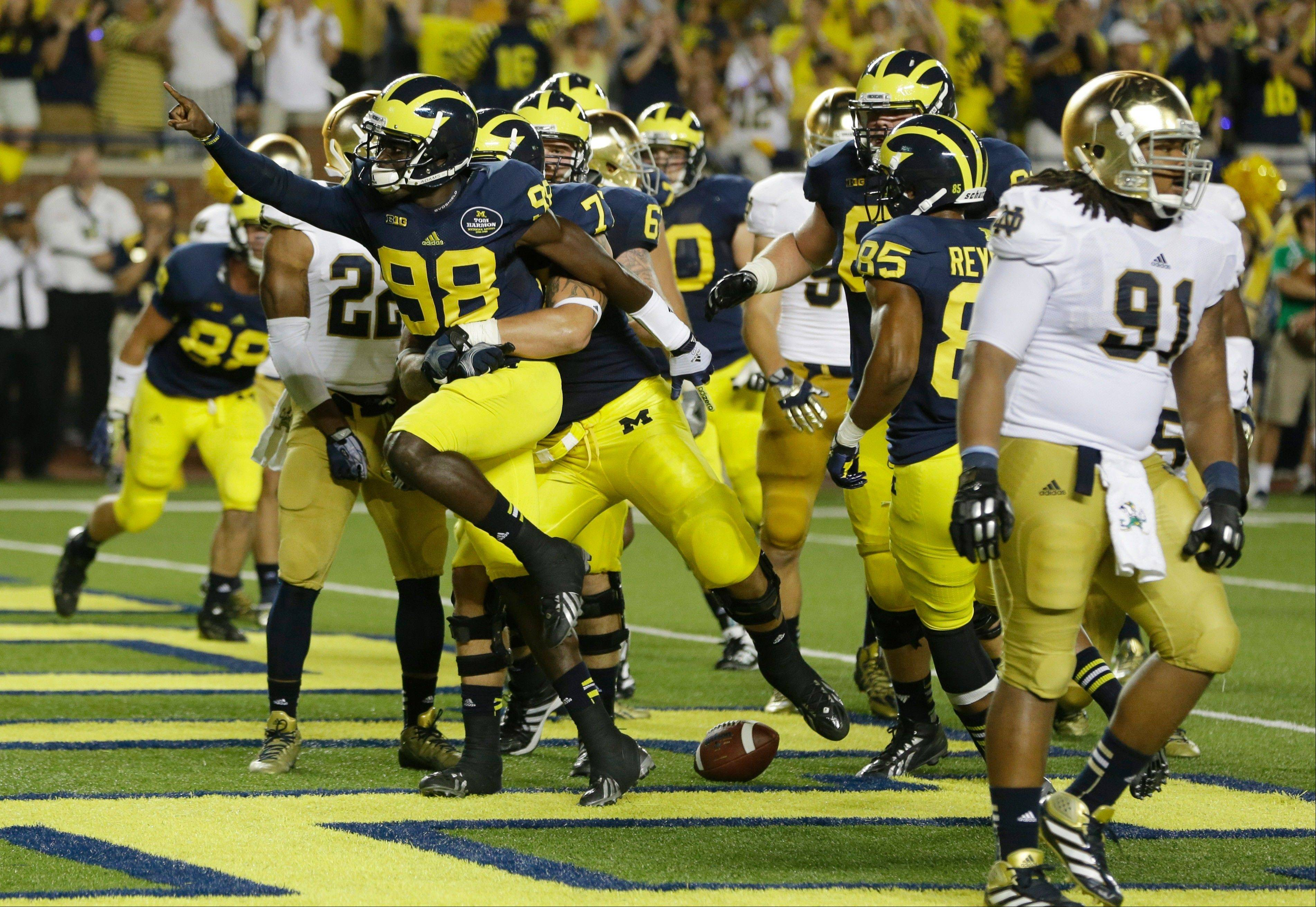 Michigan quarterback Devin Gardner (98) celebrates his touchdown during the second quarter of Saturday night's against Notre Dame in Ann Arbor, Mich.