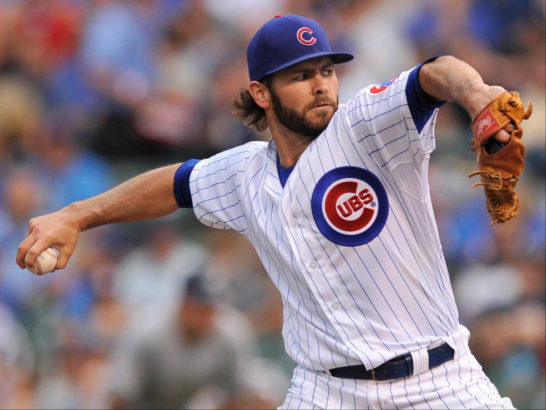 Cubs starter Jake Arrieta delivers a pitch during the first inning Saturday against the Milwaukee Brewers in Chicago.