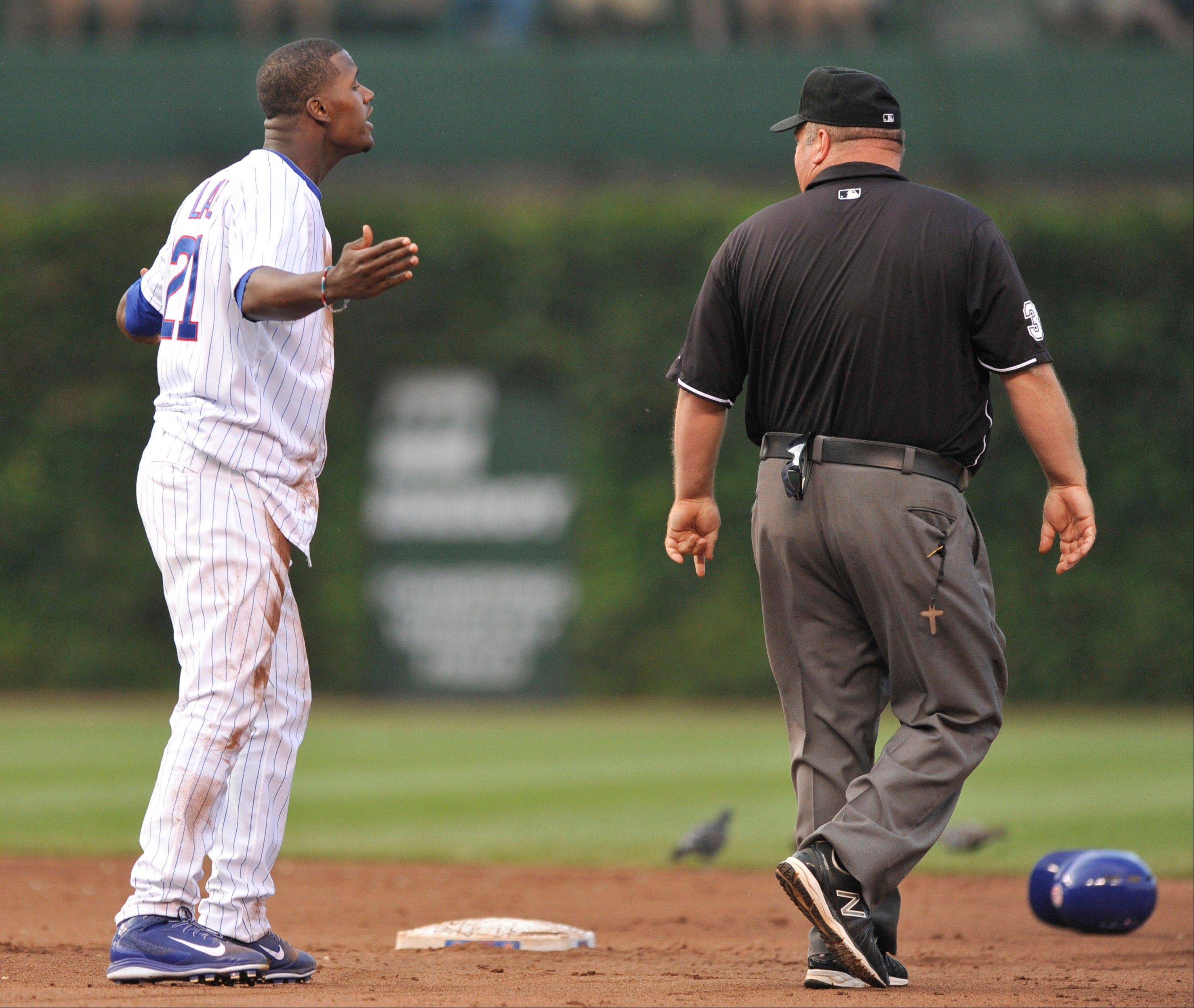 The Cubs' Junior Lake argues with second base umpire Wally Bell after being caught stealing second base during the seventh inning Saturday against Milwaukee.