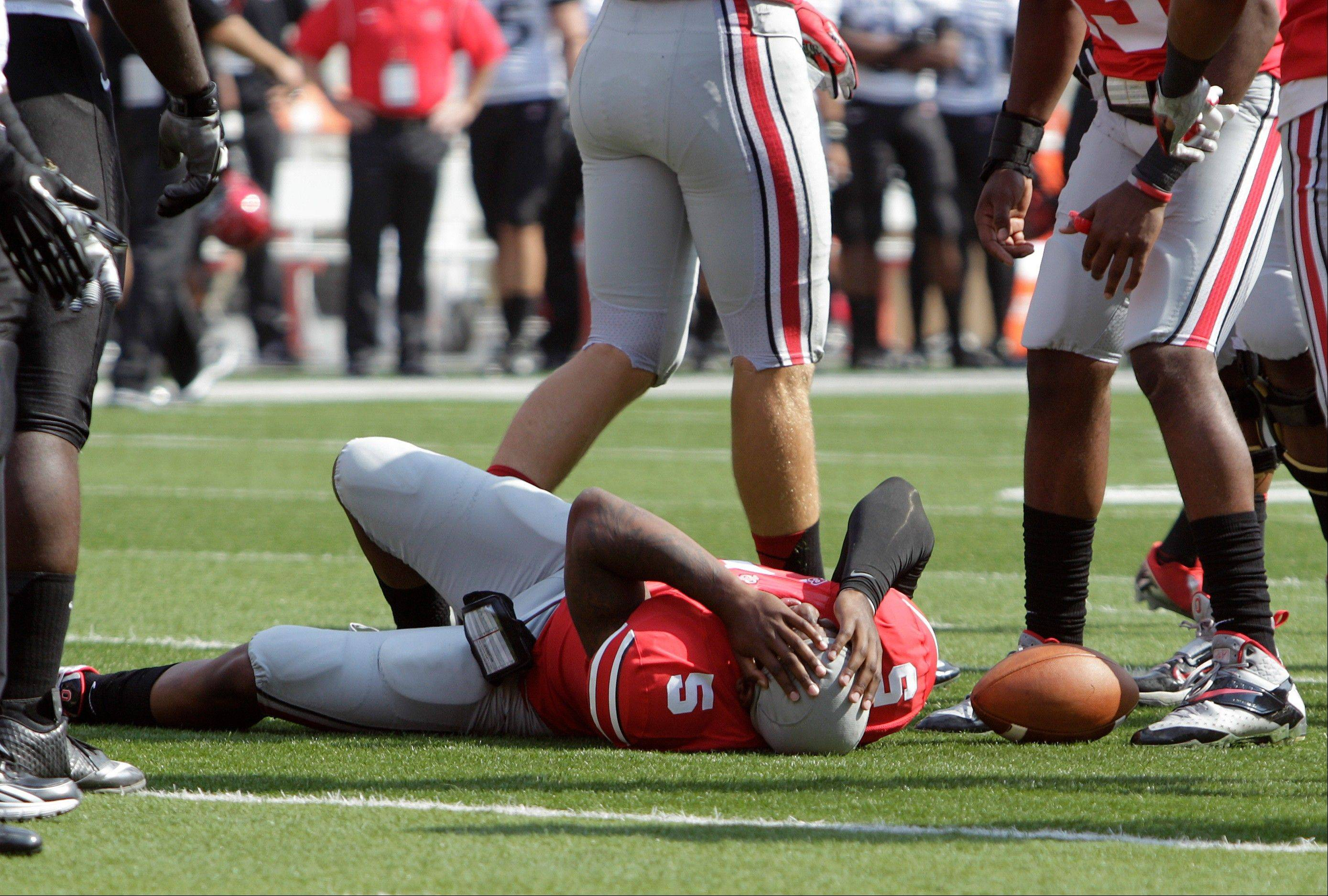 Starting quarterback Braxton Miller lies on the ground after being injured during the first quarter of Ohio State's game against San Diego State on Saturday in Columbus, Ohio.