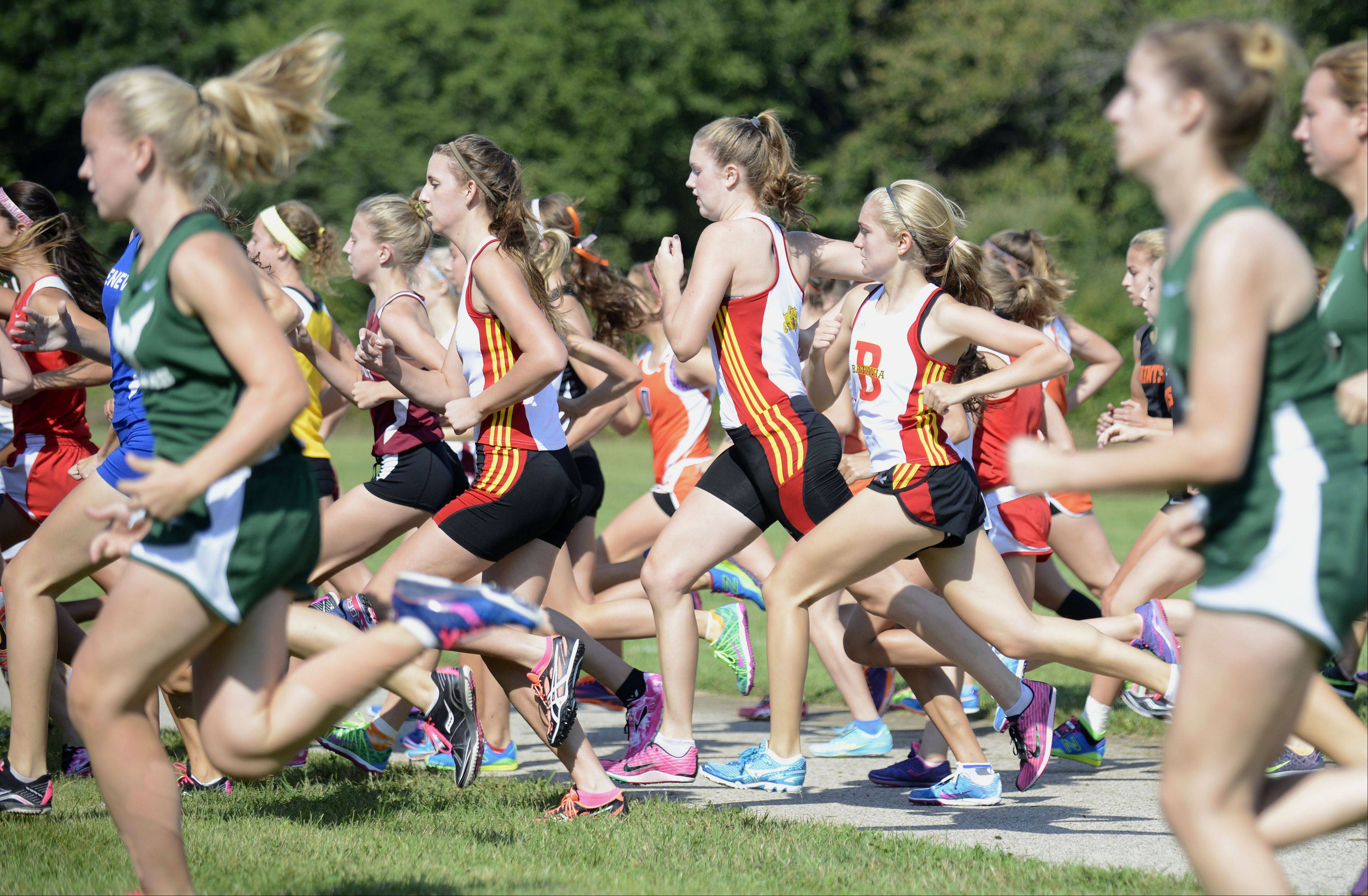 Batavia dashes from the start line of the varsity girls run in the meet at Leroy Oakes Forest Preserve in St. Charles on Saturday, September 7.