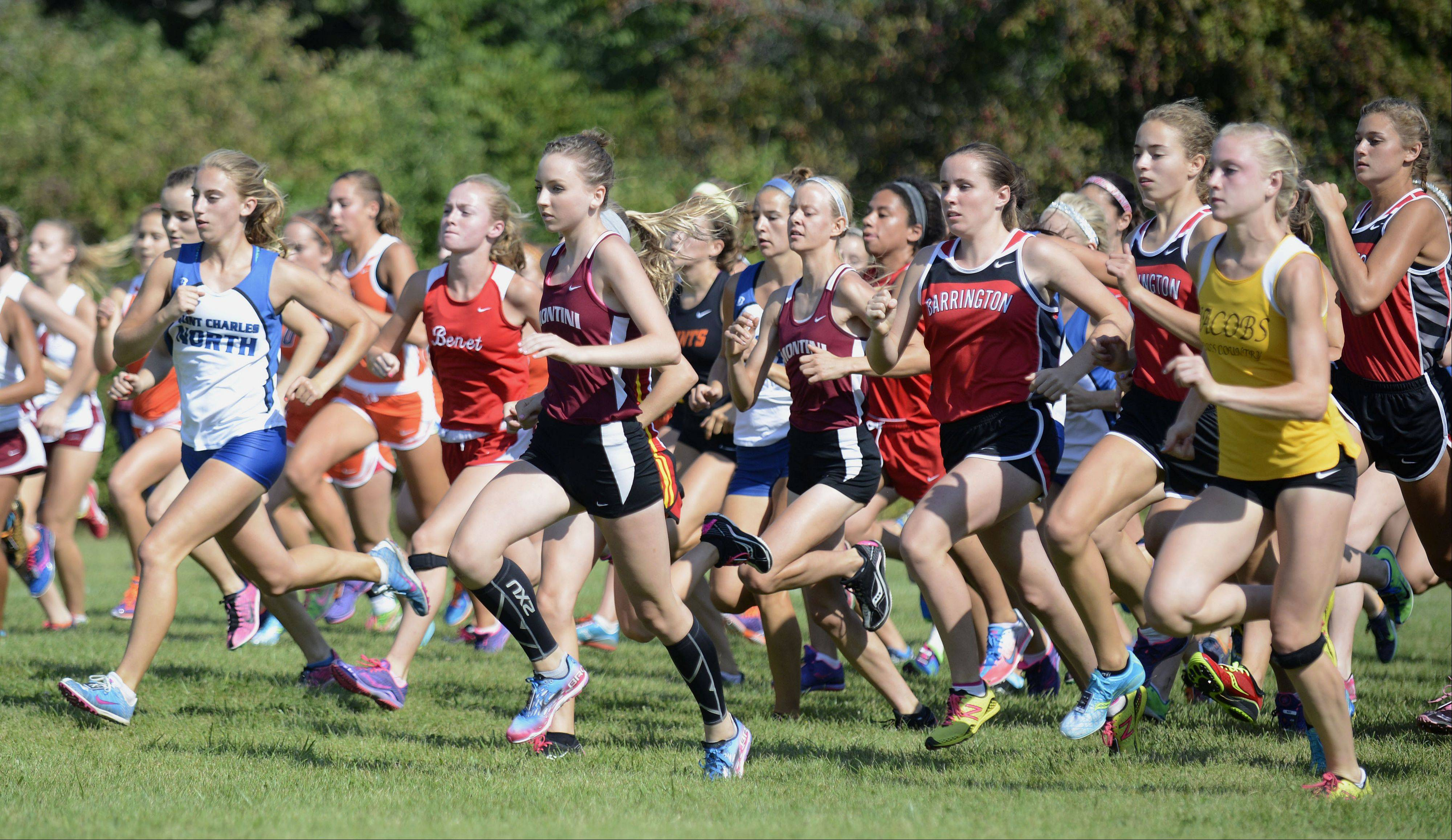 Girls varsity takes off from the starting line in the meet at Leroy Oakes Forest Preserve in St. Charles on Saturday, September 7.