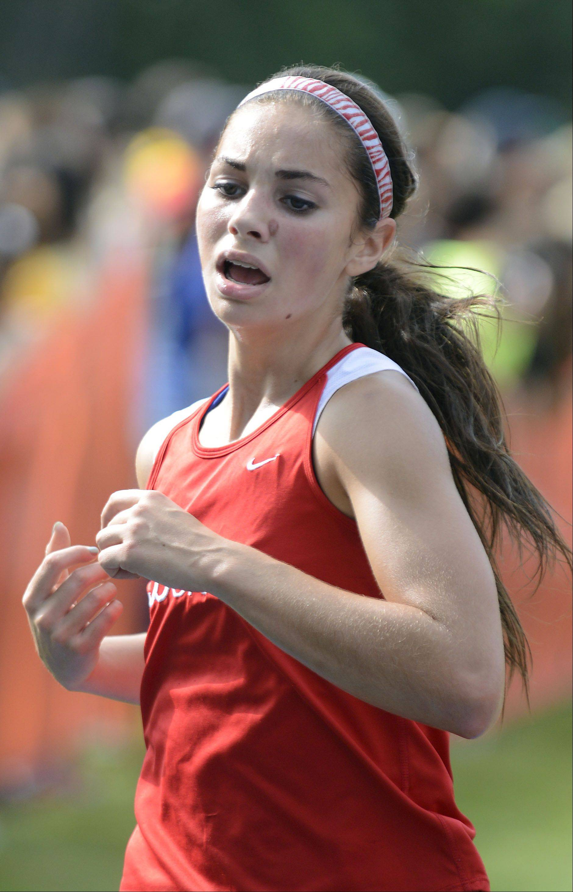 Benet's Elli Chalkey nears the finish line in the meet at Leroy Oakes Forest Preserve in St. Charles on Saturday, September 7.