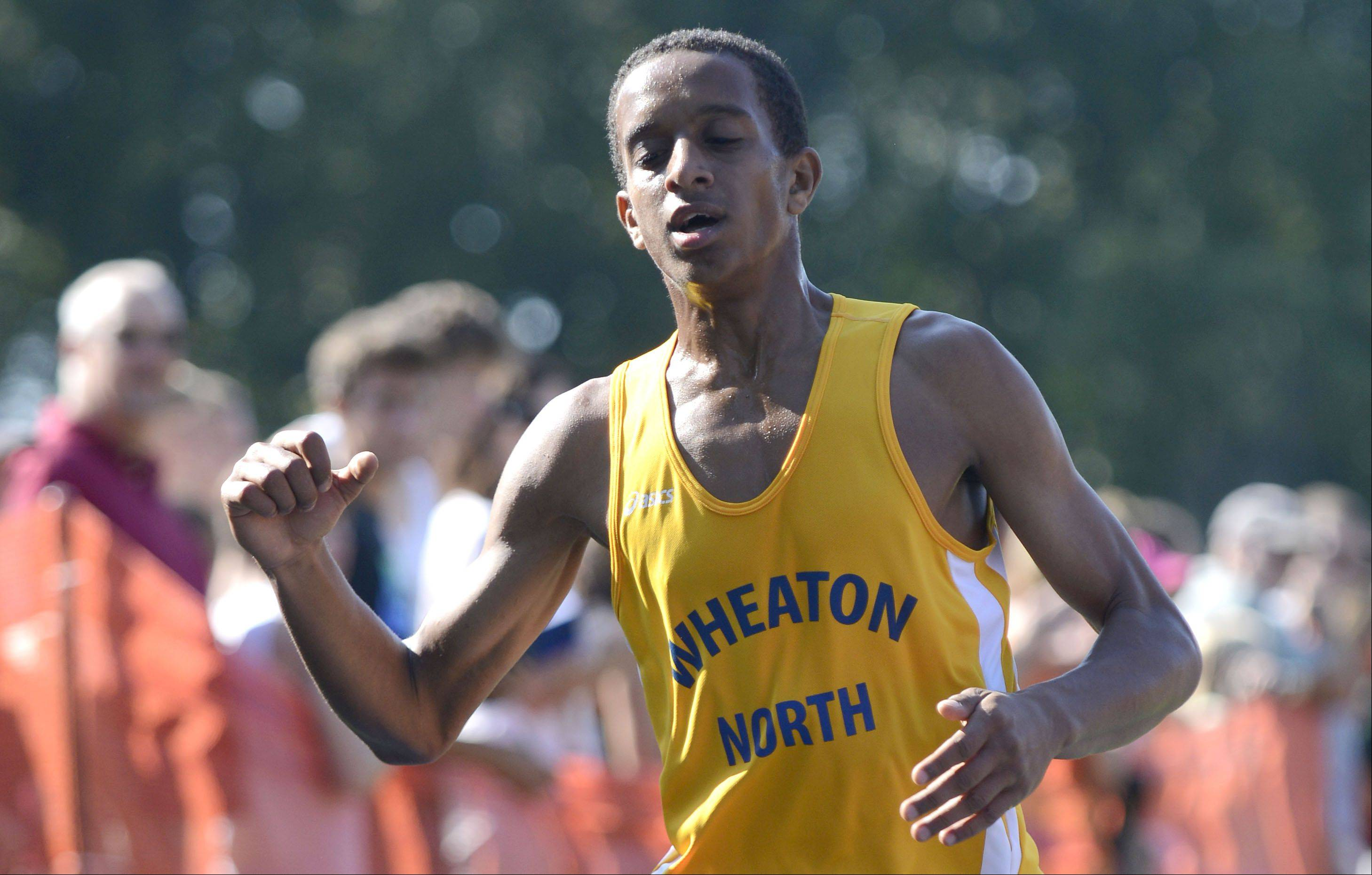 Wheaton North's Joseph Emmanuel crosses the finish line taking second place in varsity in the meet at Leroy Oakes Forest Preserve in St. Charles on Saturday, September 7.