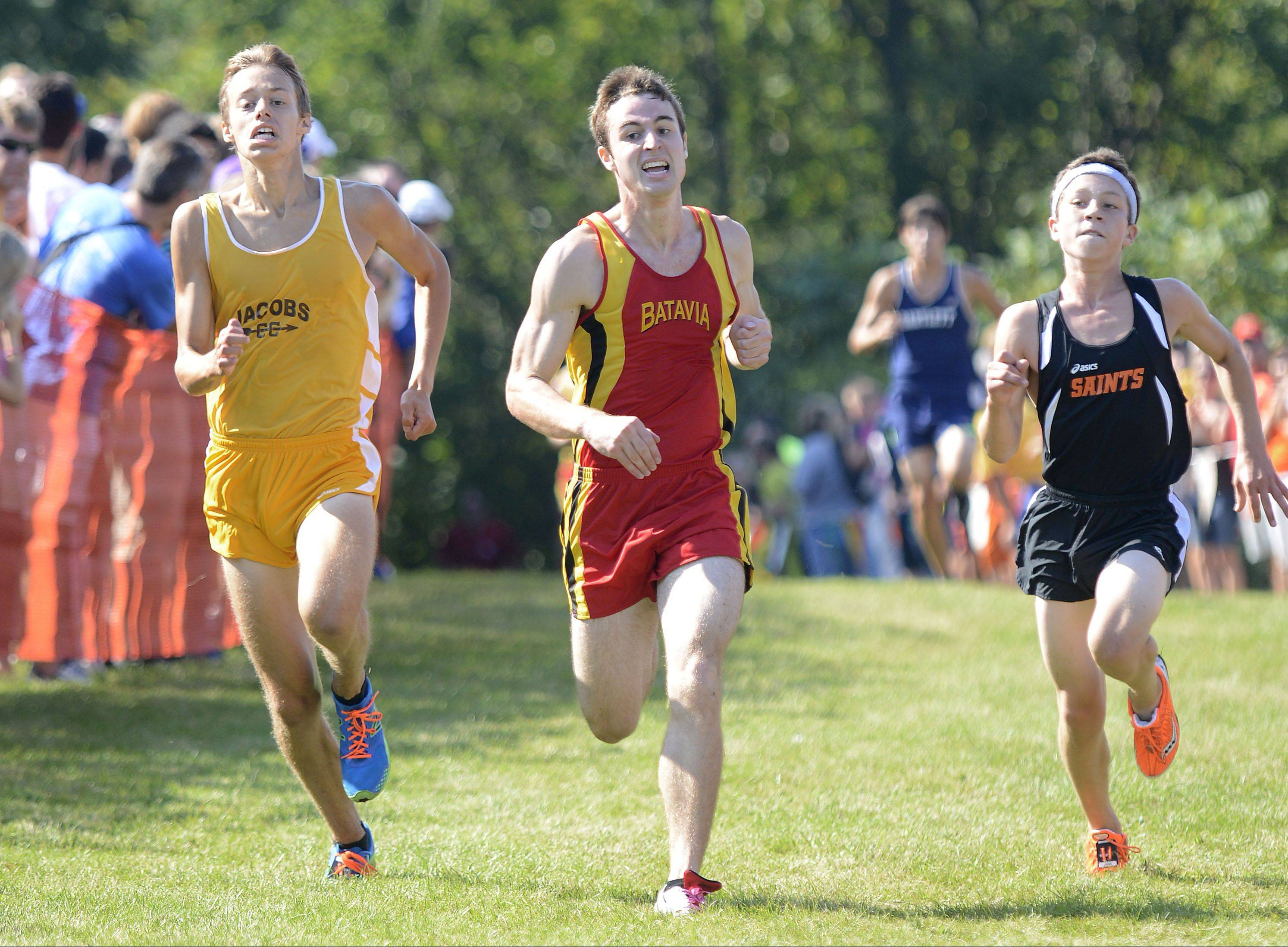 Jacobs' Corey Albrecht, Batavia's Mitch Zabka and St. Charles East's Mike Gerkin battle to the finish line Saturday at Leroy Oakes Forest Preserve in St. Charles.