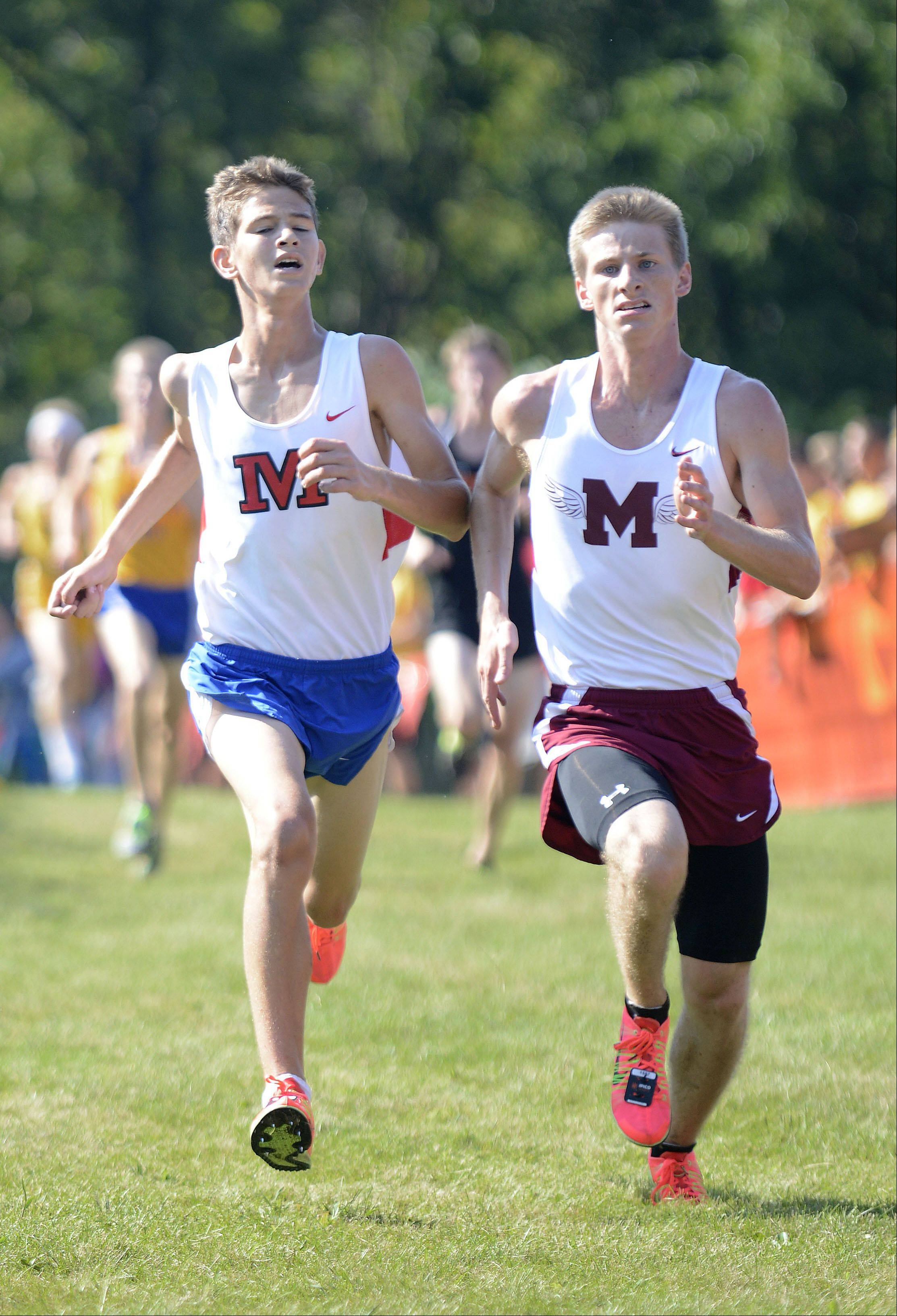 Marmion's Ethan Young, left, and Elgin's Zach Gray fight to the finish line in the meet at Leroy Oakes Forest Preserve in St. Charles on Saturday, September 7.