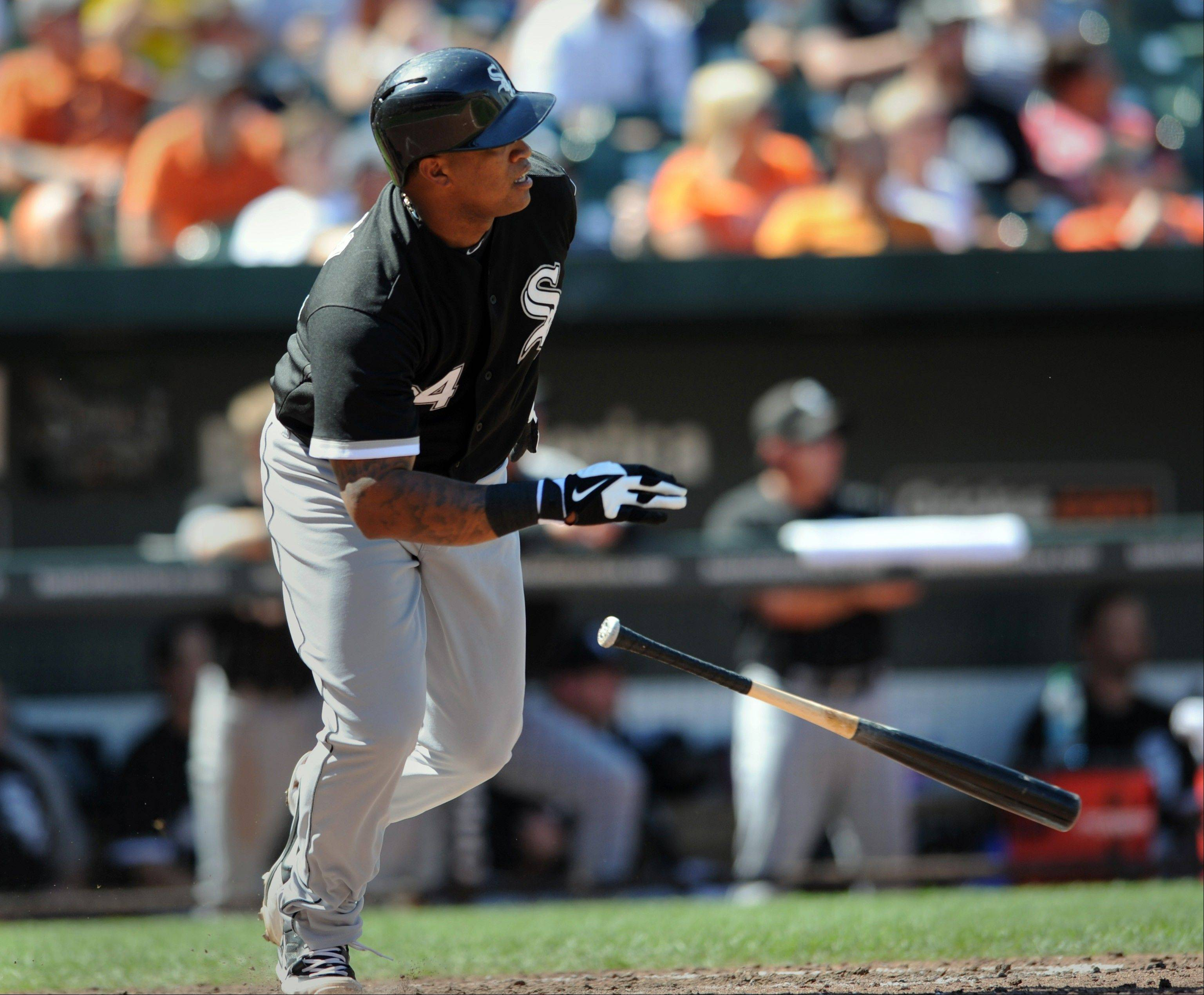 Chicago White Sox Dayan Viciedo follows through on a solo home run against the Baltimore Orioles in the fifth inning of a baseball game Saturday in Baltimore.