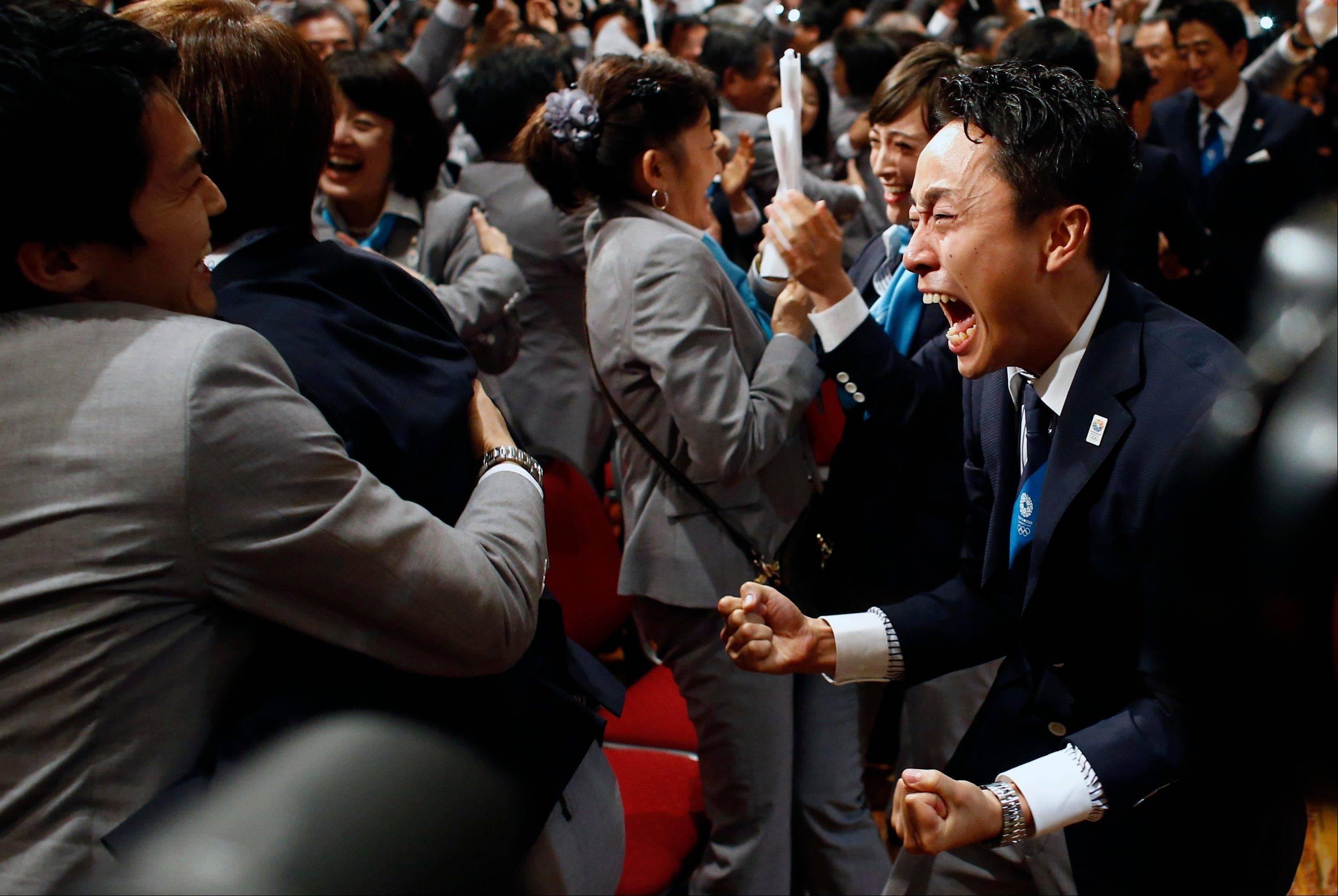Members of the Tokyo 2020 delegation celebrate after Tokyo was awarded the 2020 Olympic Games on Saturday in Buenos Aires, Argentina.