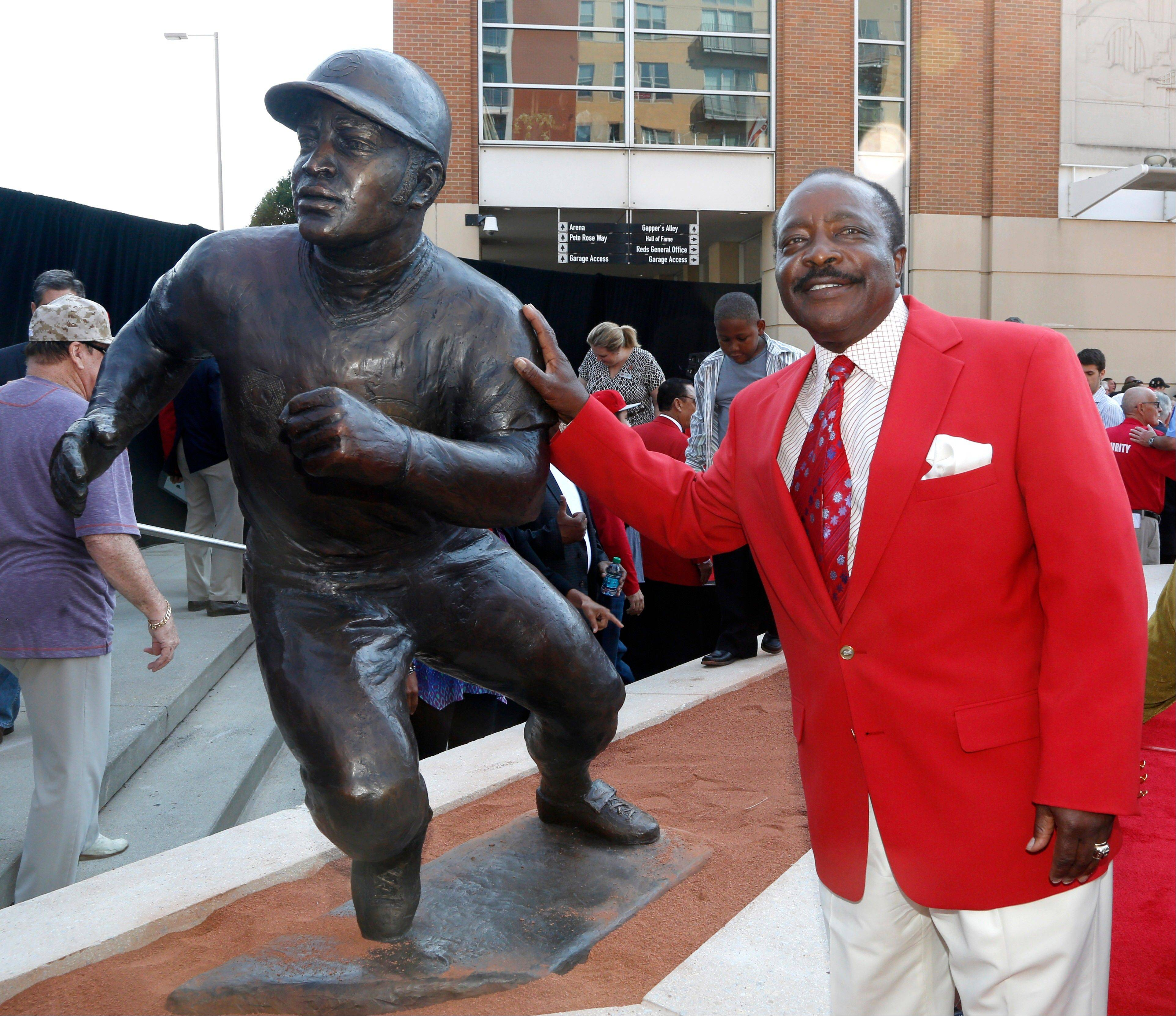 Hall of Fame second baseman Joe Morgan poses with his statue that was unveiled at Great American Ball Park on Saturday in Cincinnati.