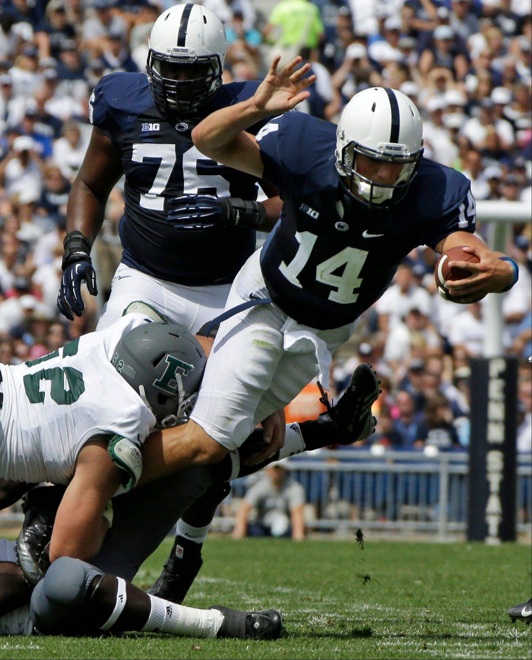 Penn State running back Zach Zwinak dives into the end zone to score on a two-yard run during the first quarter of Saturday's game against Eastern Michigan in State College, Pa.