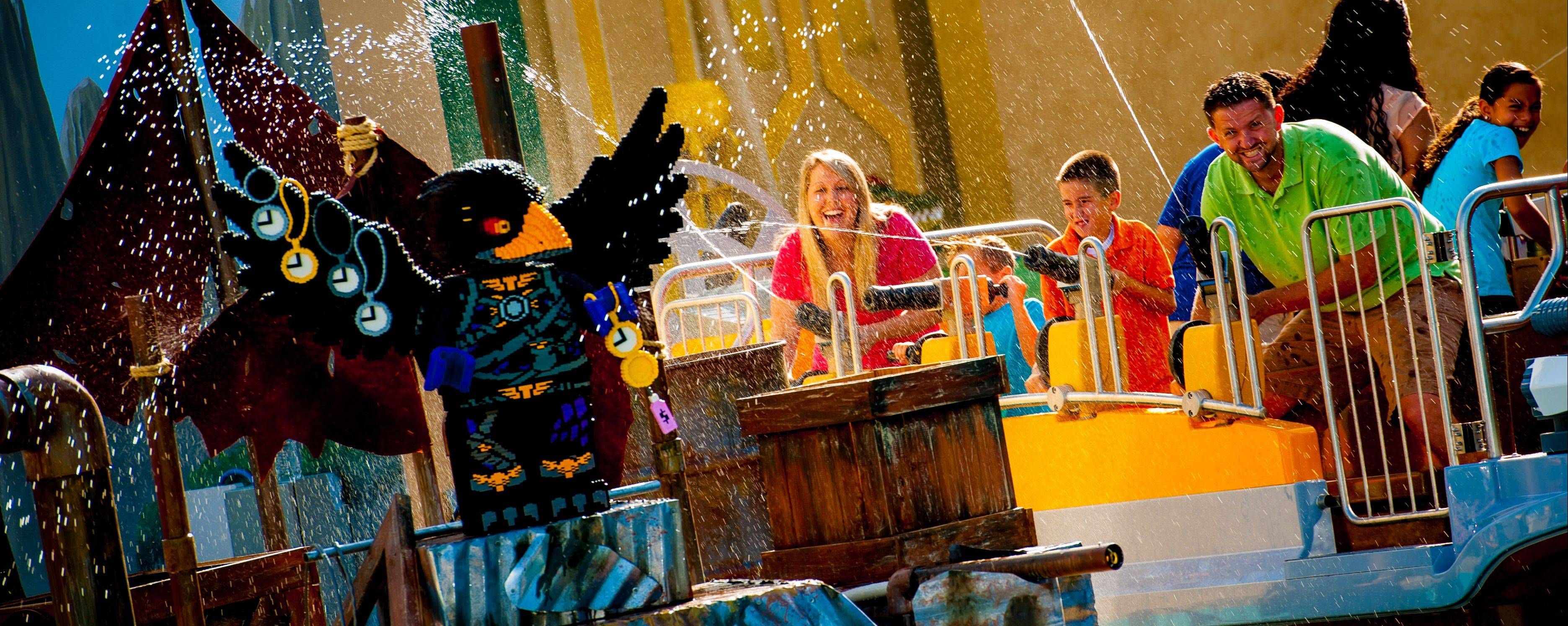 Families at Legoland Florida enjoy the theme park's new interactive water ride, The Quest for Chi. This is one of several attractions that opened at theme parks this summer.