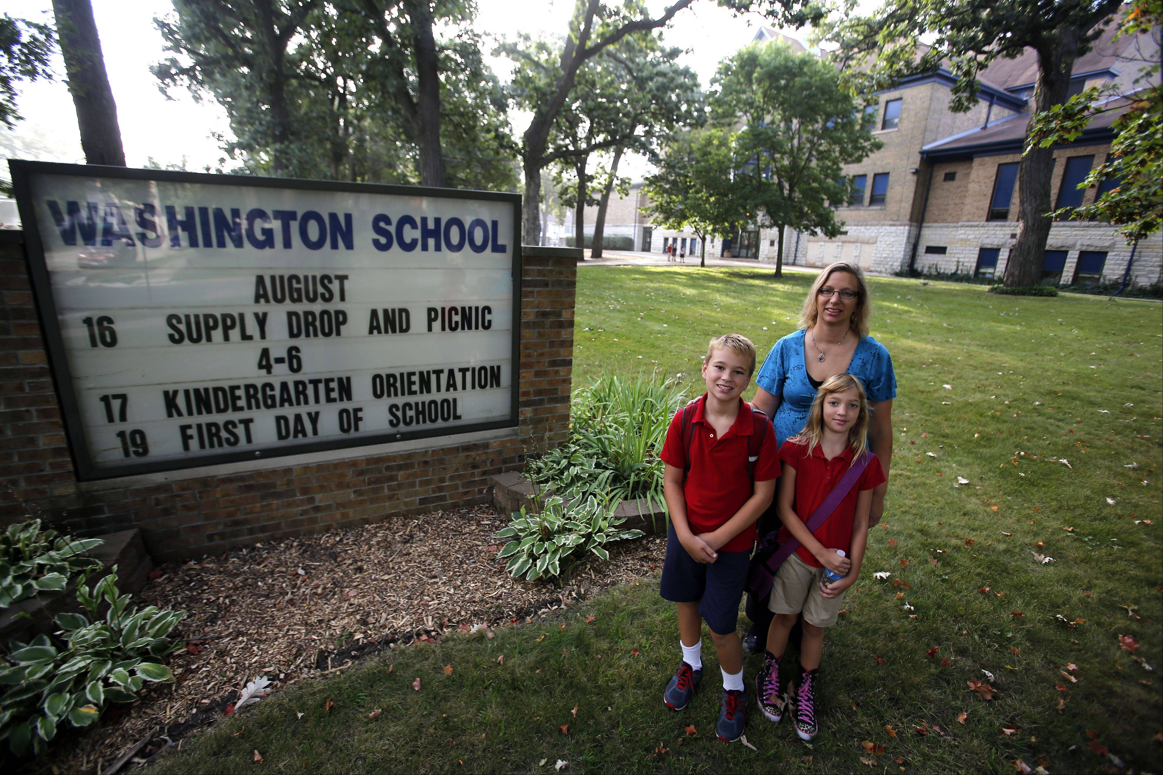 Linda Scham of Elgin thinks her children, Jakob, 10, and Kayla, 9, are getting a good education at Washington Elementary School in Elgin.