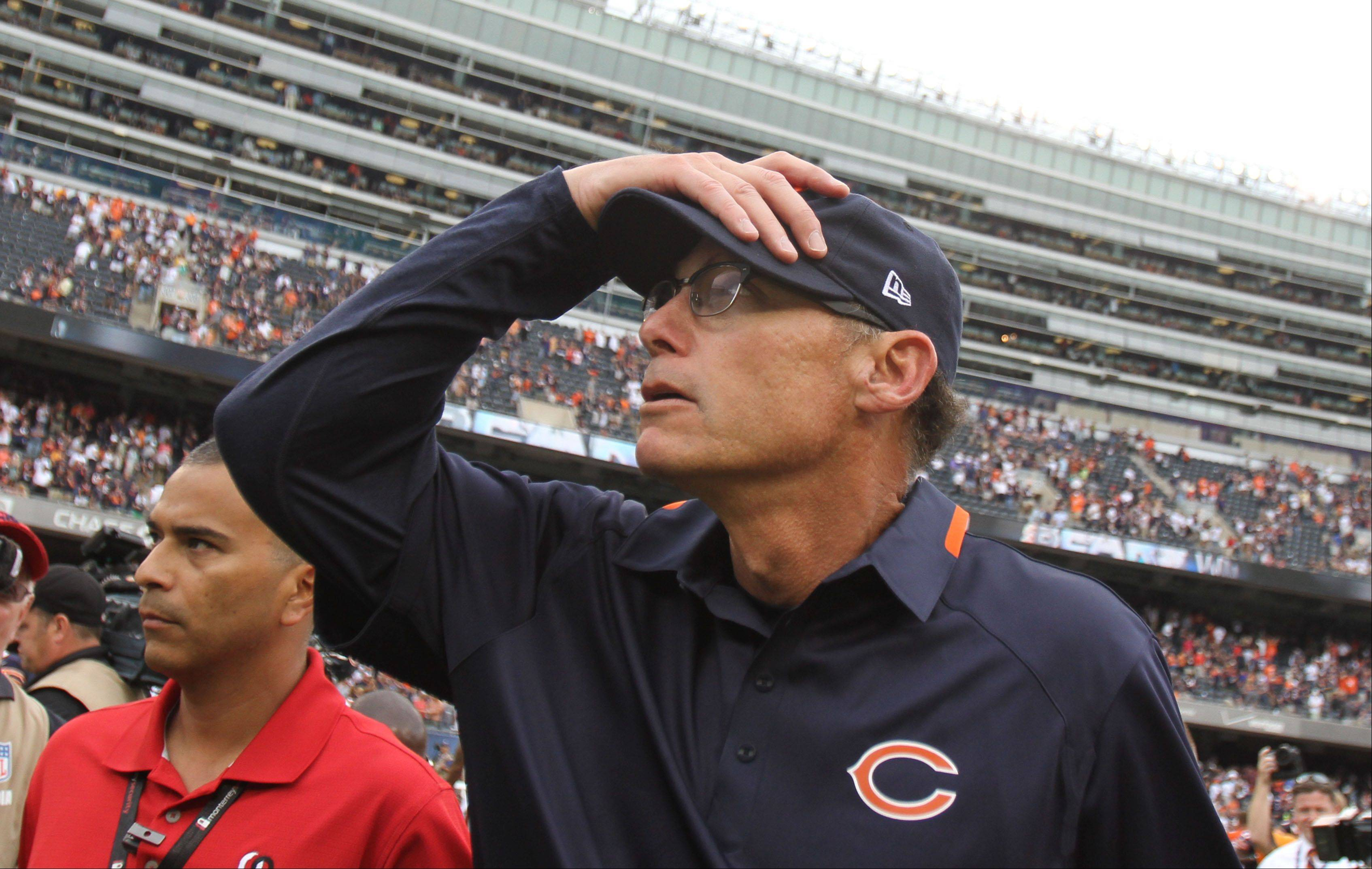 Marc Trestman looks to the stands Sunday as he leaves the field following a victory in his first game as an NFL head coach.