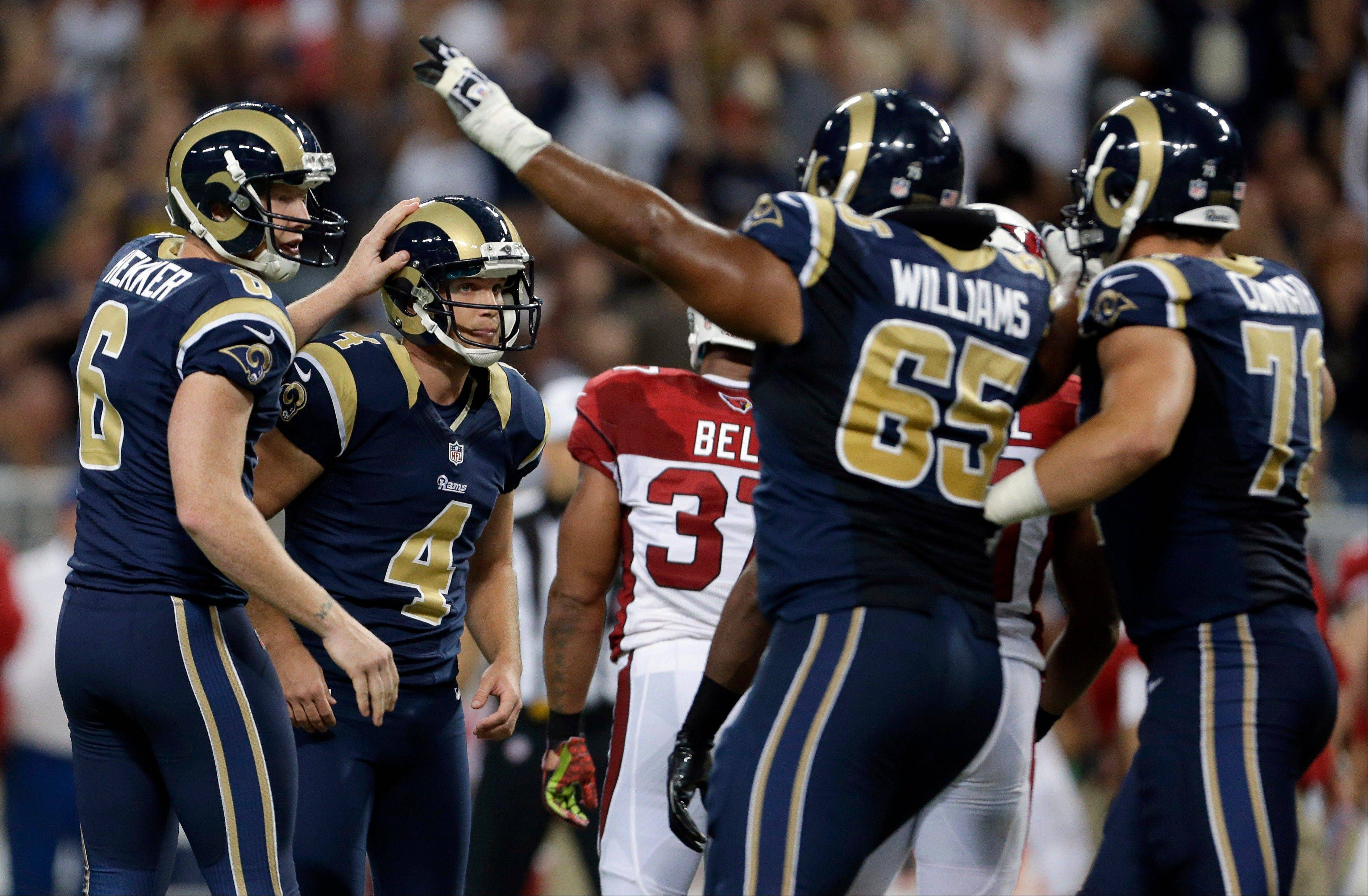 St. Louis Rams placekicker Greg Zuerlein (4) is congratulated by teammates Johnny Hekker, left, Chris Williams (65) and Matt Conrath, right, after booting a 48-yard field goal late in the fourth quarter of an NFL football game against the Arizona Cardinals, Sunday, Sept. 8, 2013, in St. Louis. The Rams won 27-24.