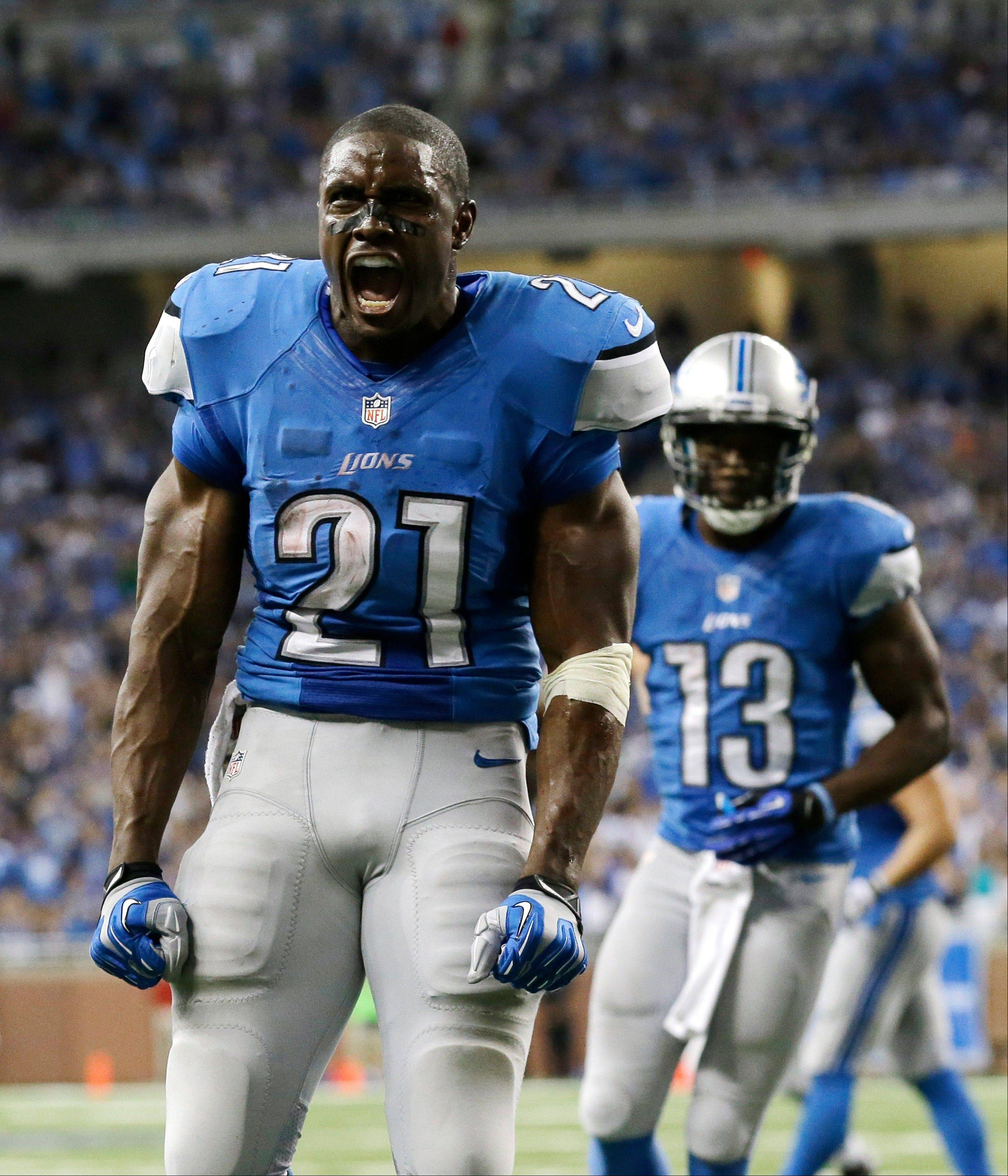 Detroit Lions running back Reggie Bush (21) reacts after scoring during the fourth quarter of an NFL football game against the Minnesota Vikings at Ford Field in Detroit, Sunday, Sept. 8, 2013.