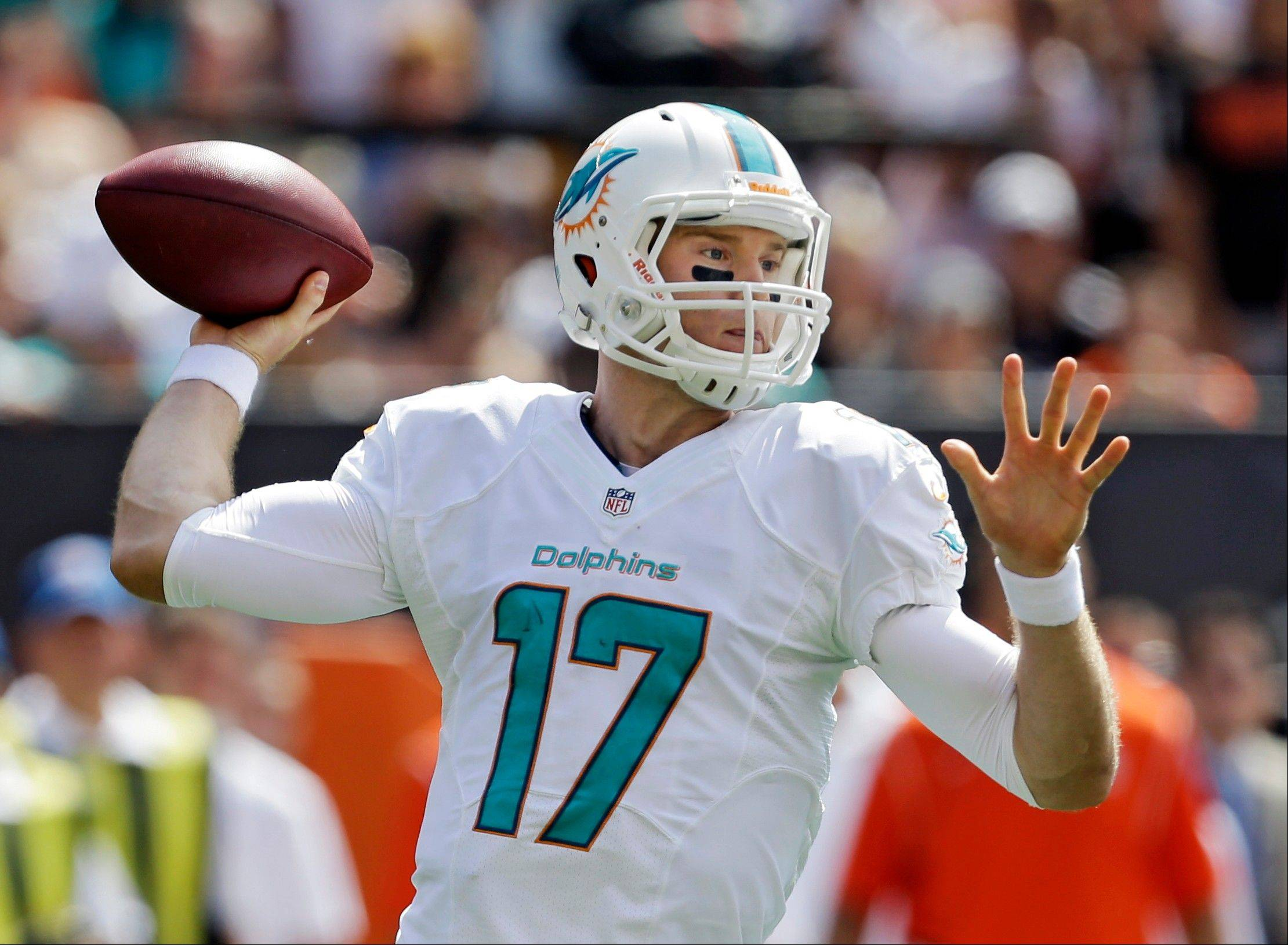Miami Dolphins quarterback Ryan Tannehill passes against the Cleveland Browns in the first quarter of an NFL football game Sunday, Sept. 8, 2013, in Cleveland.