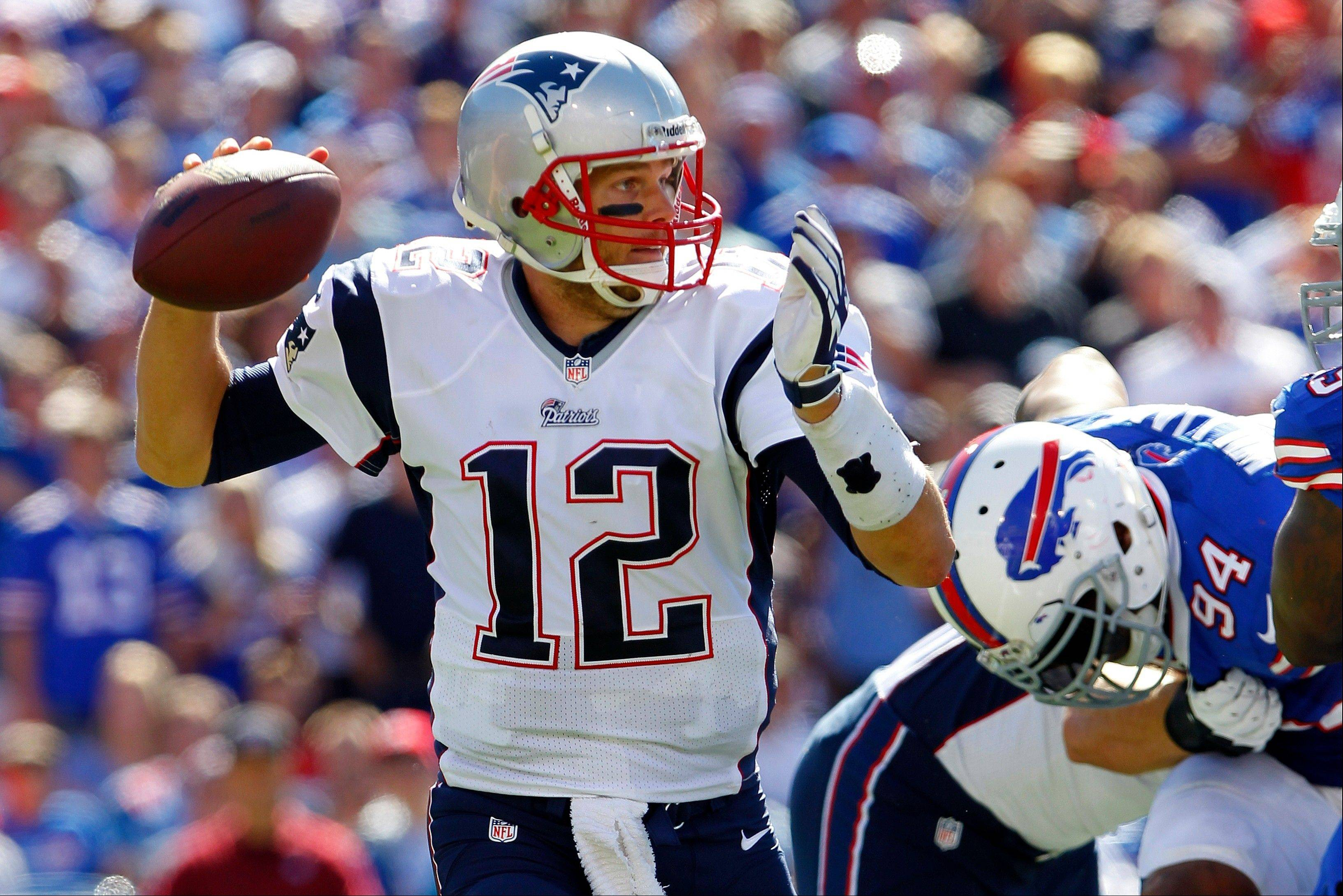 New England Patriots quarterback Tom Brady (12) throws a pass during the second half of an NFL football game against the Buffalo Bills, Sunday, Sept. 8, 2013, in Orchard Park.