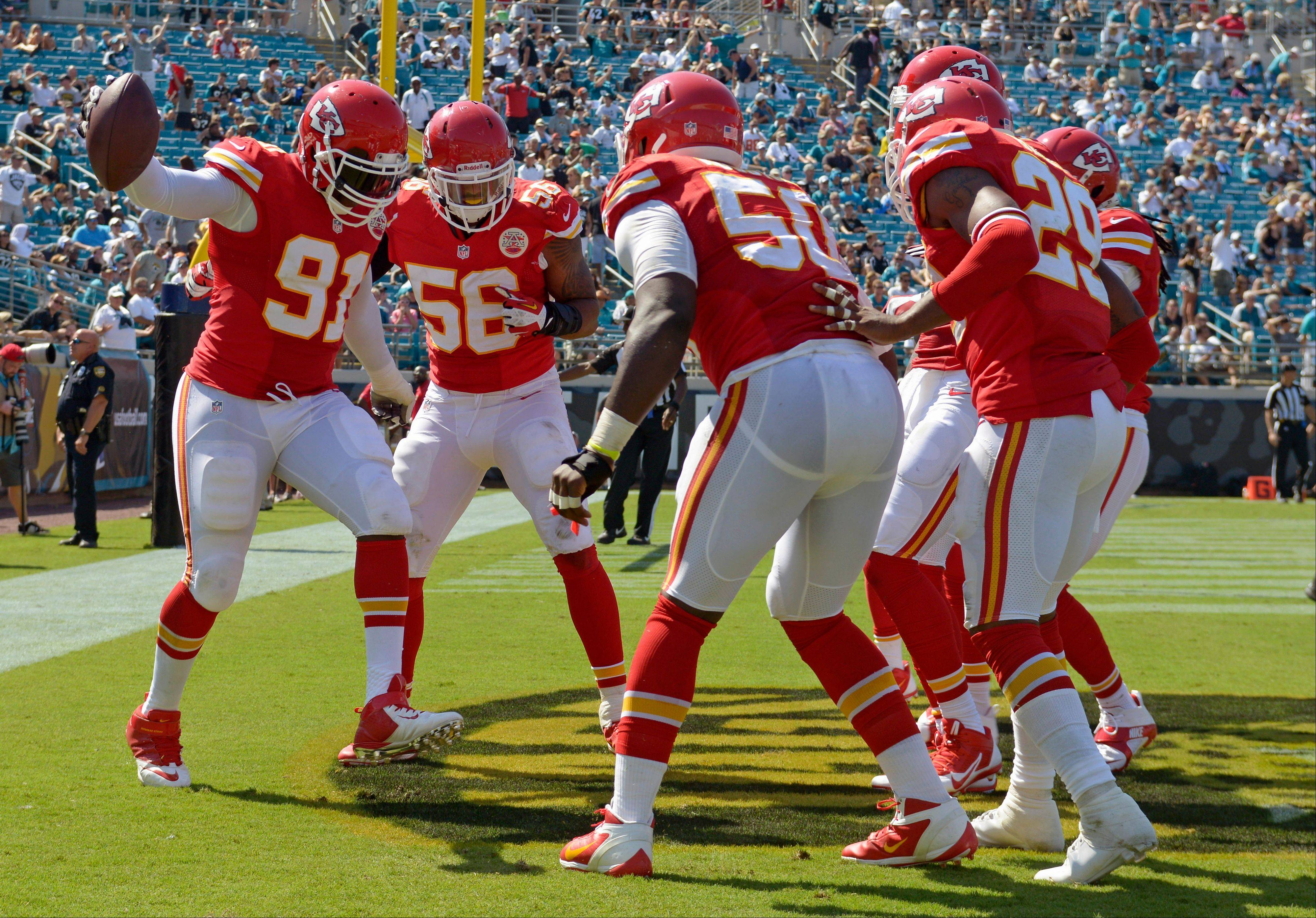 Kansas City Chiefs outside linebacker Tamba Hali (91) celebrates with teammates after intercepting a pass and returning it for a 10-yard touchdown against the Jacksonville Jaguars during the second half of an NFL football game in Jacksonville, Fla., Sunday, Sept. 8, 2013.