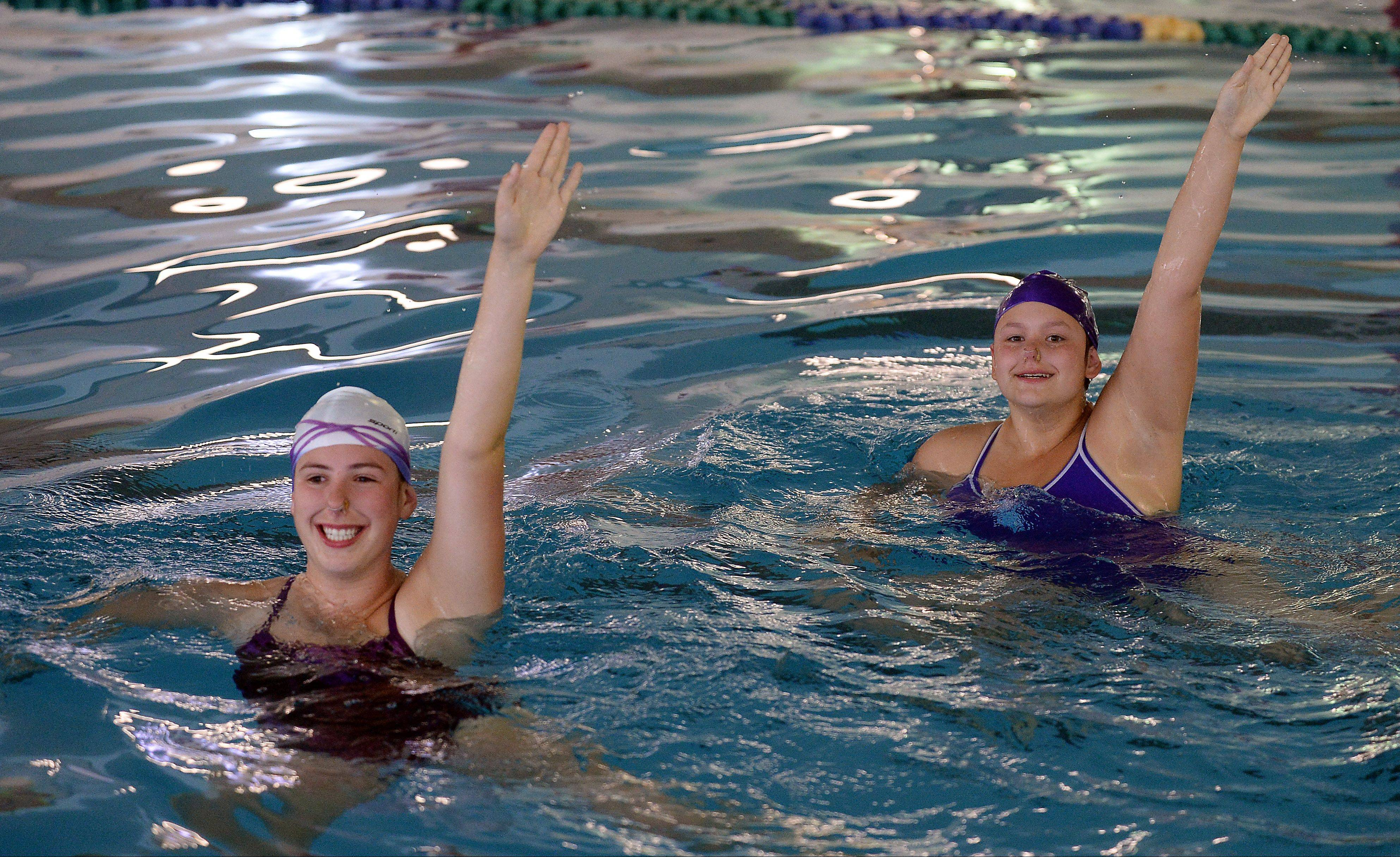 Alice Kenny, 15, of Mount Prospect, left, and Megan Moyer, 16, of Barrington practice their synchronized swimming as part of the Aqua Sprites at the Lattof YMCA.