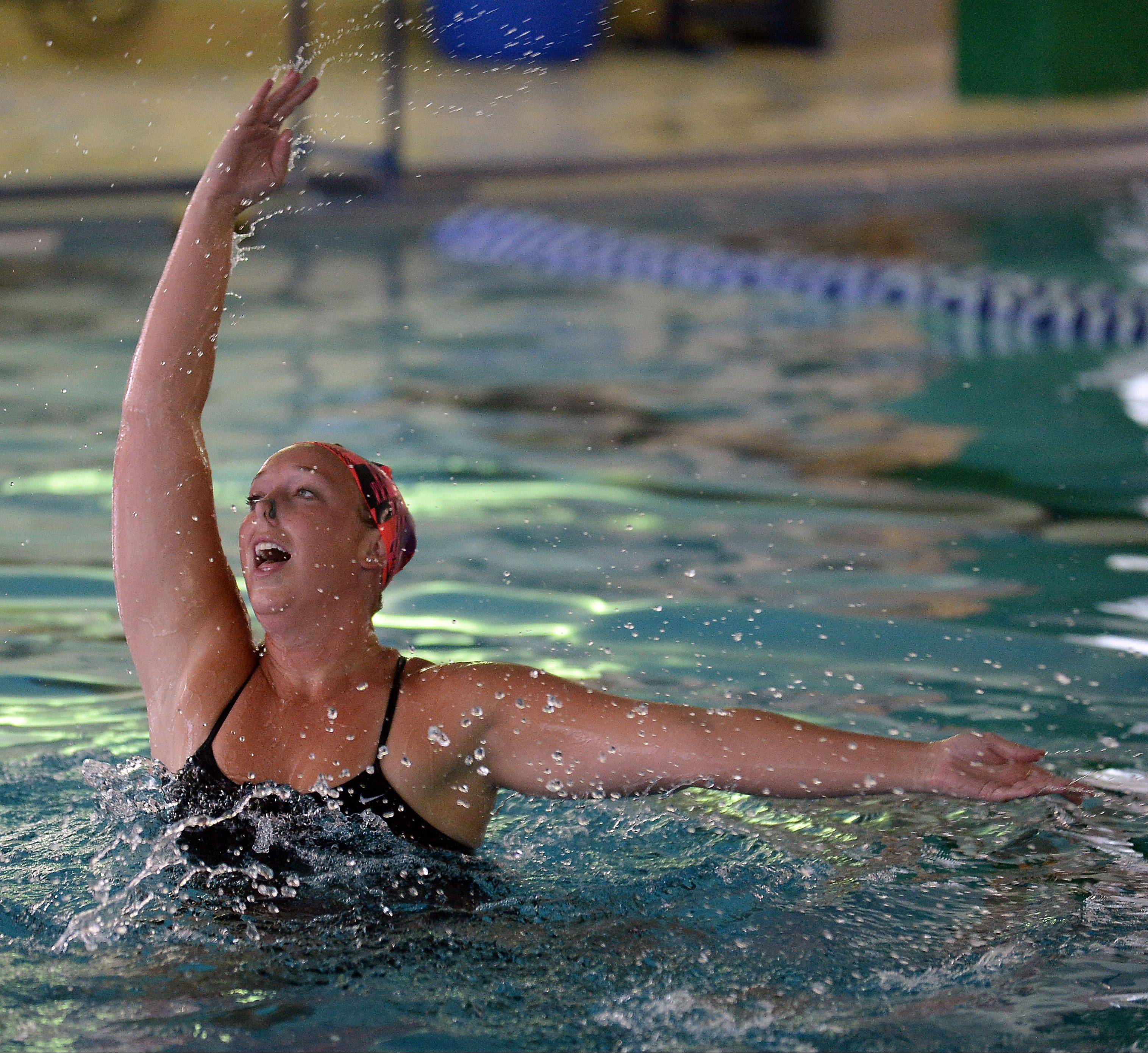 Heather Dueball, 26, of Arlington Heights practices her synchronized swimming routine as part of the AquaSprites at the Lattof YMCA.