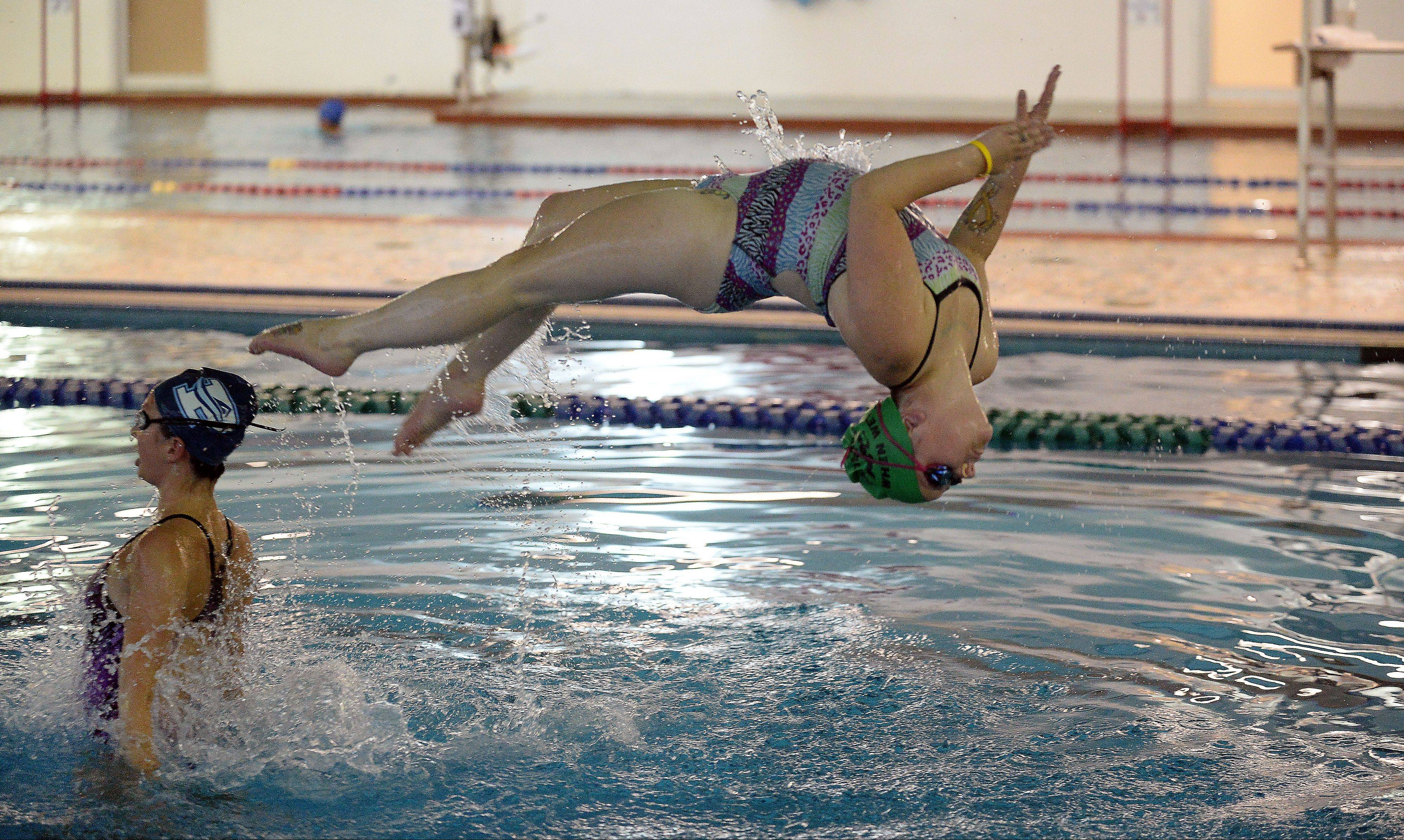 Nina Hart, 24, of Des Plaines practices her synchronized swimming as part of the AquaSprites at the Lattof YMCA.