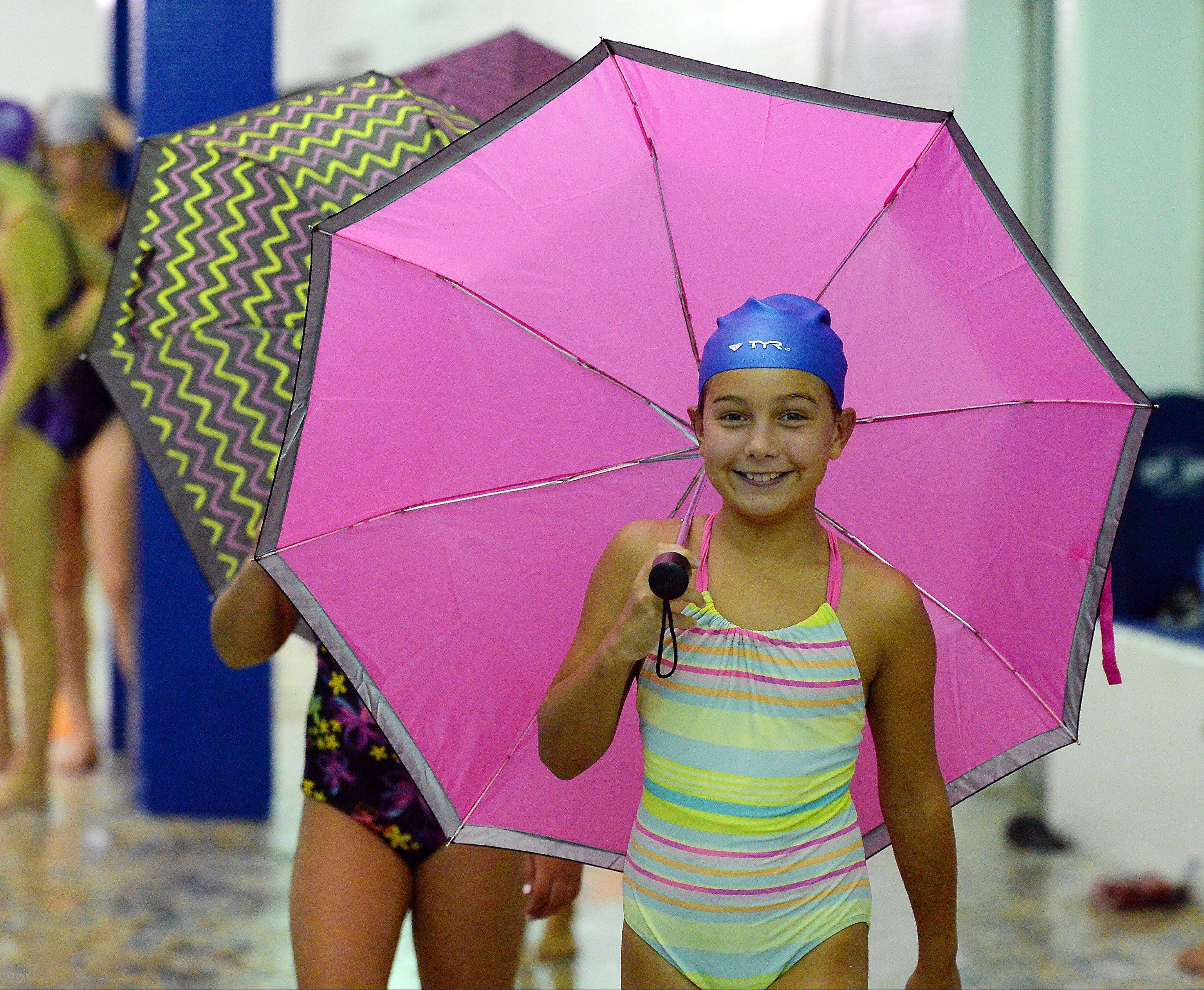 Lexi Dorula, 9, of Prospect Heights leads the rest of the Aqua Sprites as they practice their synchronized swimming to the song Singin' in the Rain by Gene Kelly at the Lattof YMCA.