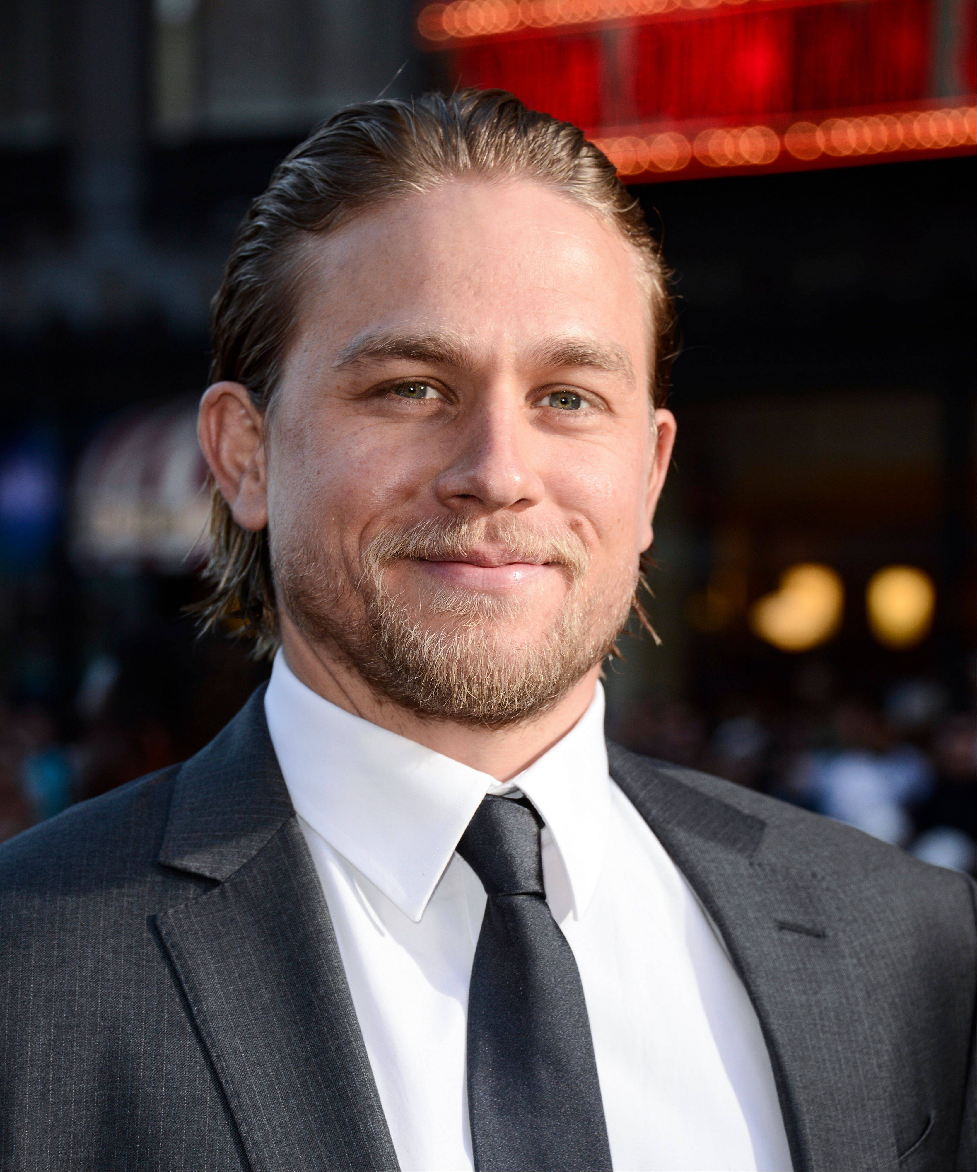 "Actor Charlie Hunnam arrives on the red carpet at the season six premiere screening of the television series ""Sons of Anarchy"" at the Dolby Theatre on Saturday, Sept. 7, 2013 in Los Angeles. Hunnam says the coveted role in ""50 Shades of Grey"" is a new challenge, but he's sure it the racy scenes won't be too much of a problem for him."