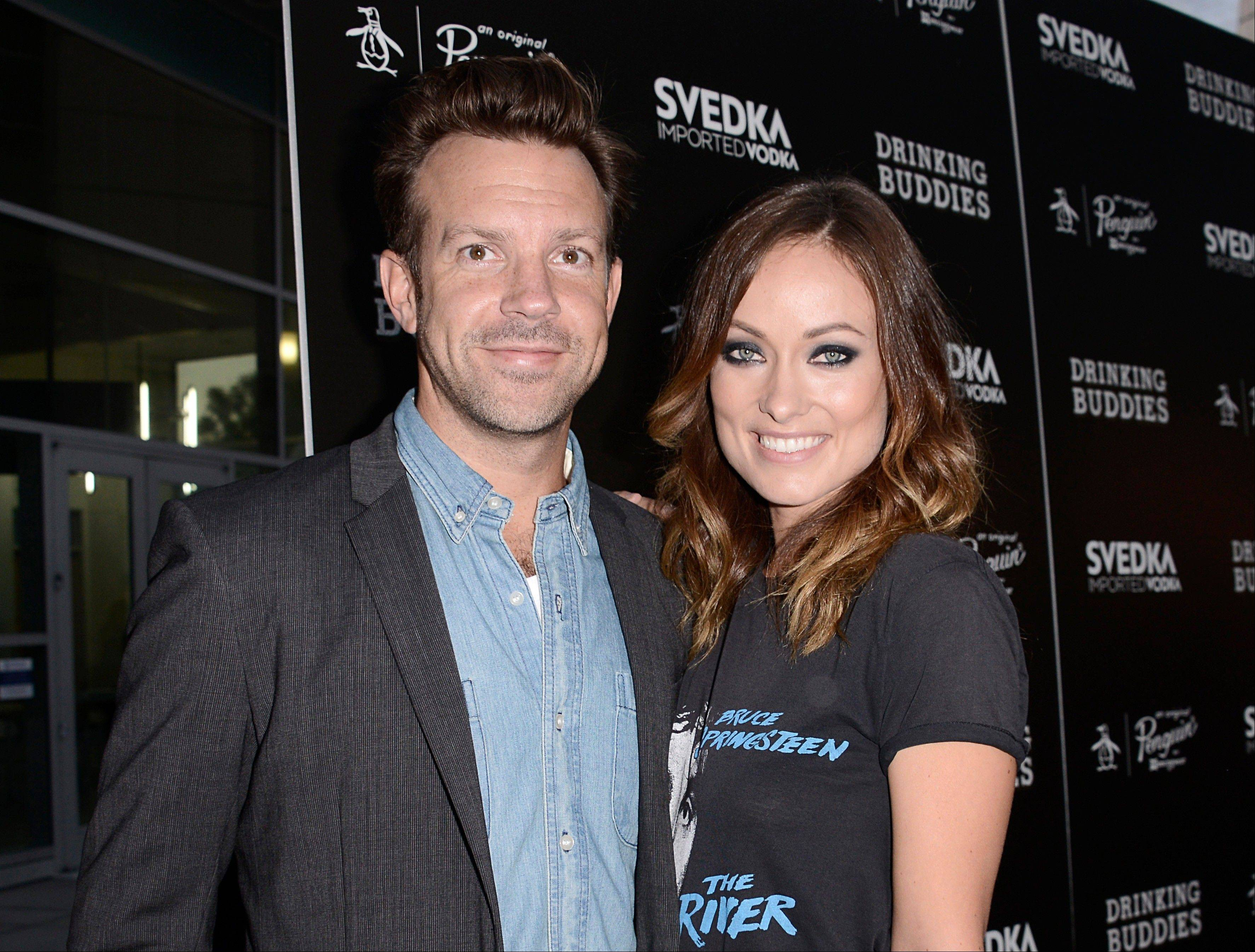 "Jason Sudeikis and Olivia Wilde arrive on the red carpet at the screening of the feature film ""Drinking Buddies"" at the ArcLight Hollywood in Los Angeles. Wilde and Sudeikis have been engaged since very early this year but have yet to spill details about their wedding plans -- they're too busy."