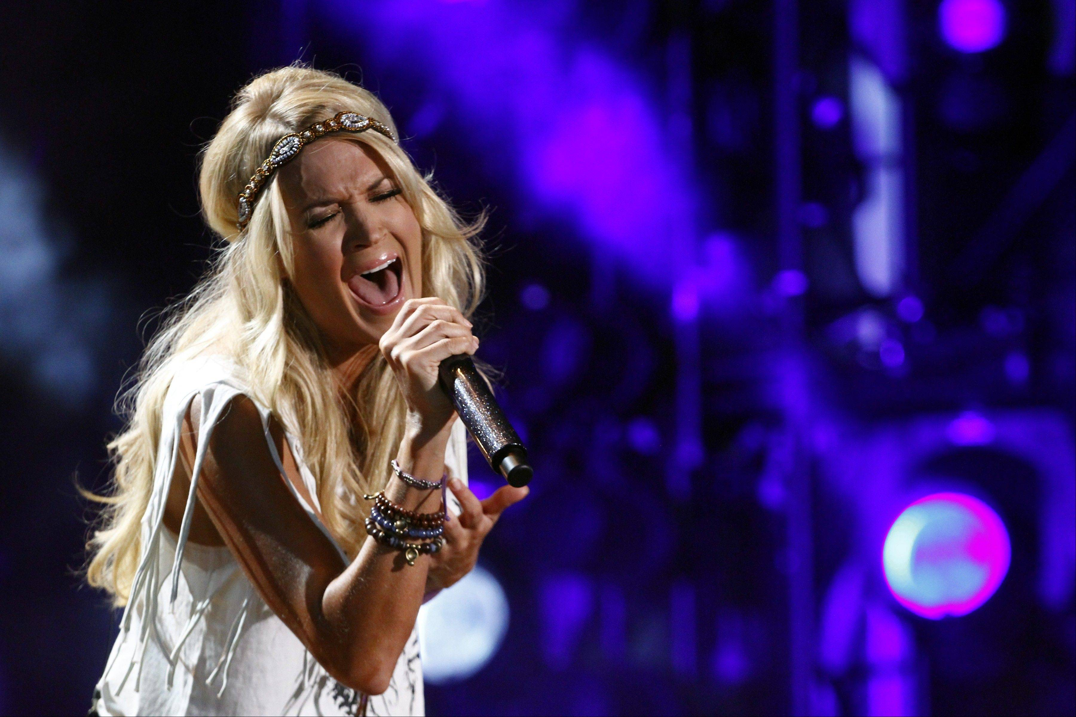 "Carrie Underwood will sing ""Waiting All Day for Sunday Night,"" the new theme song for ""Sunday Night Football."""