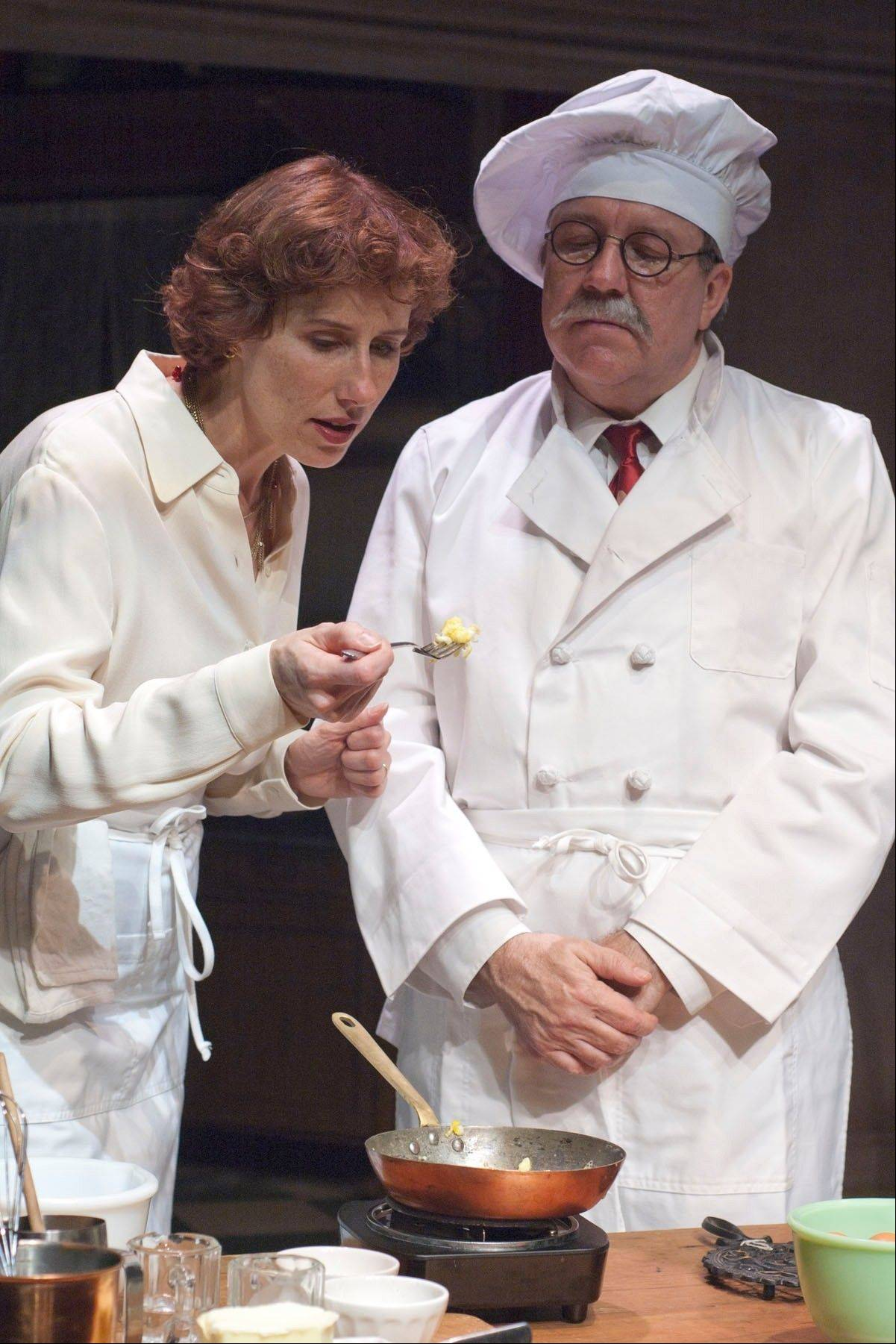 "Julia Child (Karen Janes Woditsch) learns how to cook from M. Max Bugnard (Terry Hamilton) in ""To Master the Art"" at the Broadway Playhouse at Water Tower Place in Chicago."