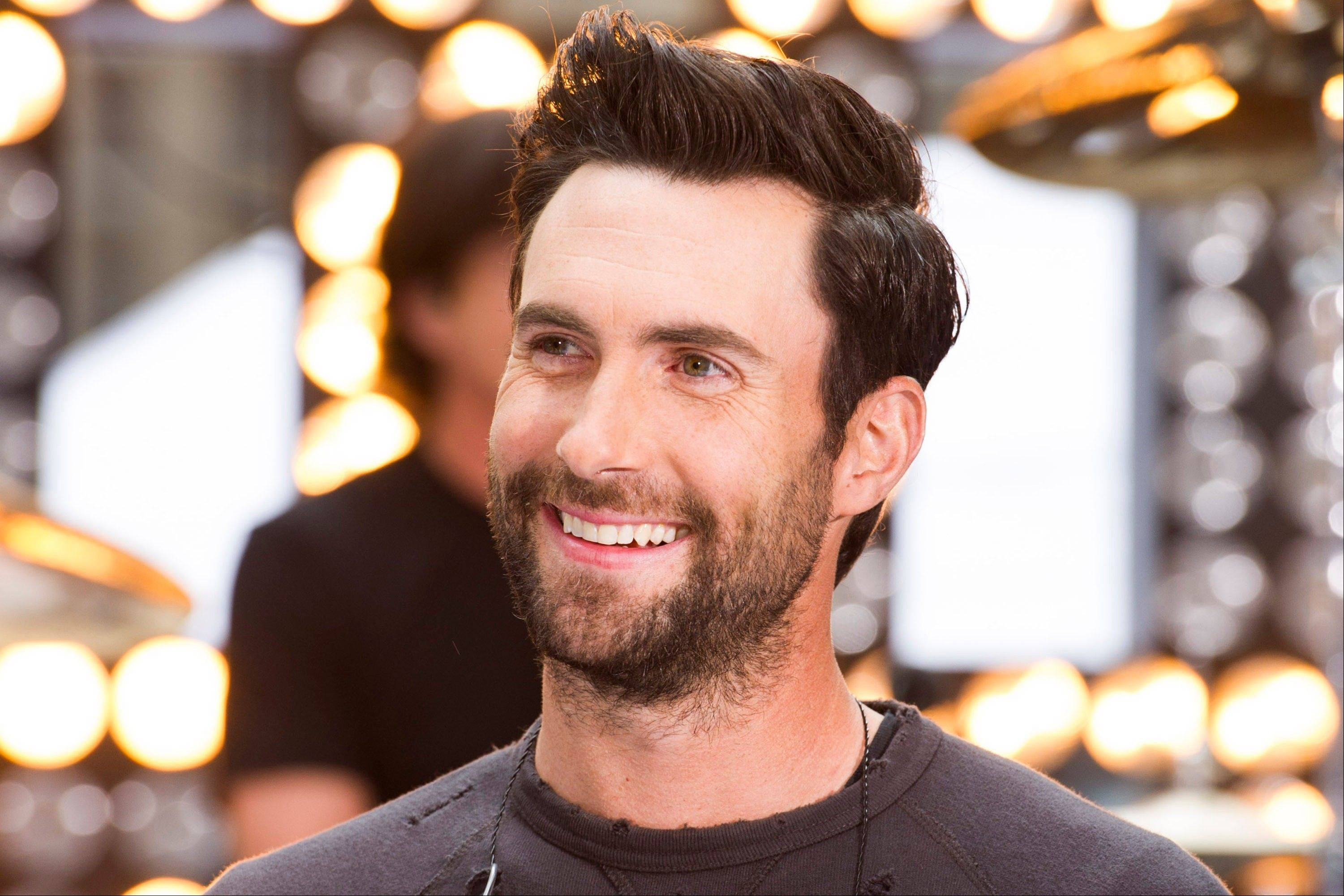 Maroon 5 lead singer Adam Levine has previewed his menswear line for Kmart. Henley Ts, plaid button-down shirts, baseball caps and a camouflage cargo jacket were part of the collection that will land in 500 stores on Oct. 1.