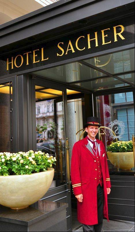 A doorman greets guests at the Hotel Sacher, a grand old hotel opposite the Opera House.
