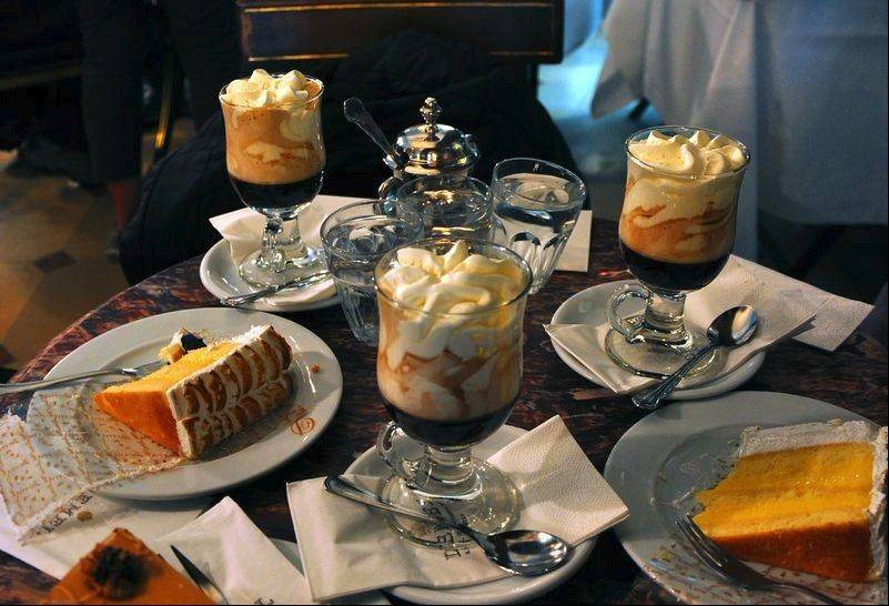 Coffee and cake are served on marble tabletops at Demel, a classic Viennese coffeehouse on the pedestrian street, Kohlmarkt.