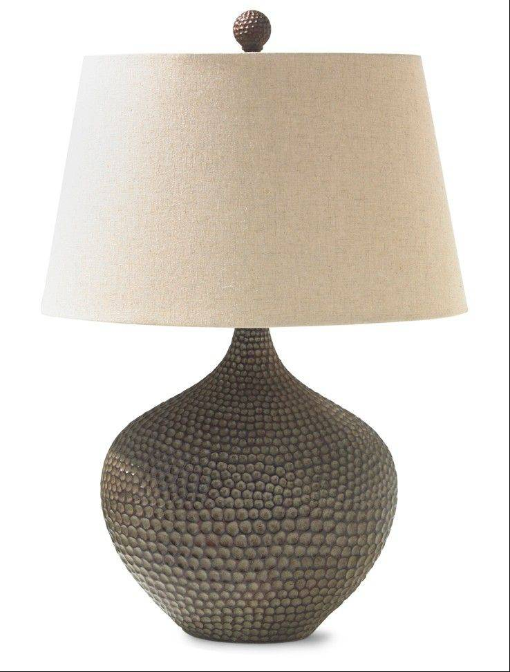Carved, weathered and washed woods are a strong trend this fall, as seen in this lamp with a hammered wood base.