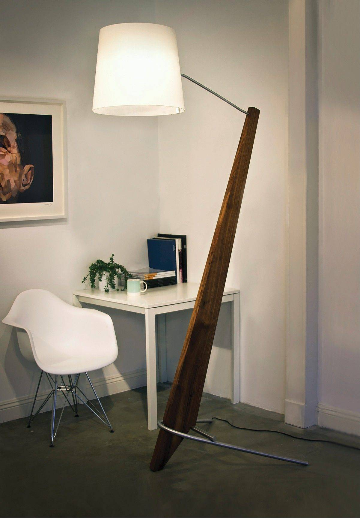 An 84-inch-tall Silva Giant lamp crafted from aluminum and walnut produces a dramatic, yet sleek fixture that epitomizes contemporary design.