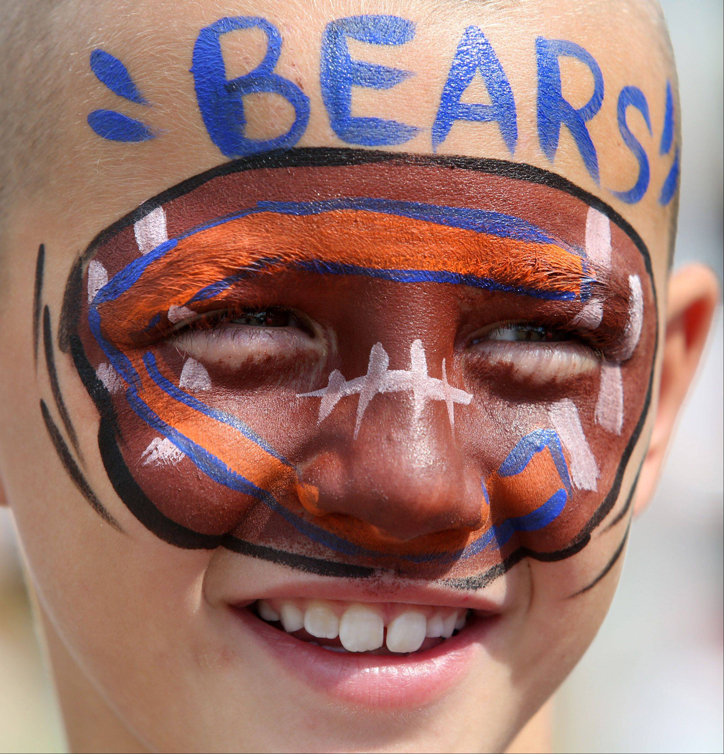 Zachary Kazumura, 9, may live in Wisconsin, but he gets his Chicago Bears game face on at a face painting booth at Antioch's Fall Arts and Crafts Fair on Main Street in Antioch Saturday. Zachary dad, Jeff Kazumura, works in Lake County.